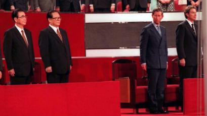 Chinese Foreign Minister Qian Qichen (L), Premier Li Peng (2nd-L), President Jiang Zemin (3rd-L), Britain's Prince Charles (2nd-R) and Prime Minister Tony Blair (R) stand to attention between the flag poles following the Chinese national flag raising at the handover ceremony in Hong Kong July 1.