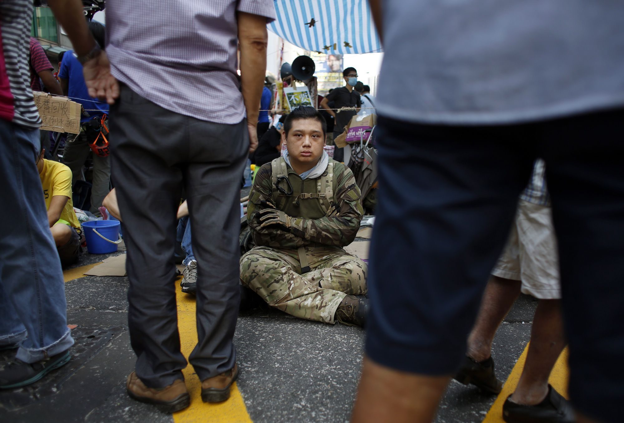A pro-democracy protester guards a tent from possible attack by anti- protesters in Mong Kok on Oct. 5.
