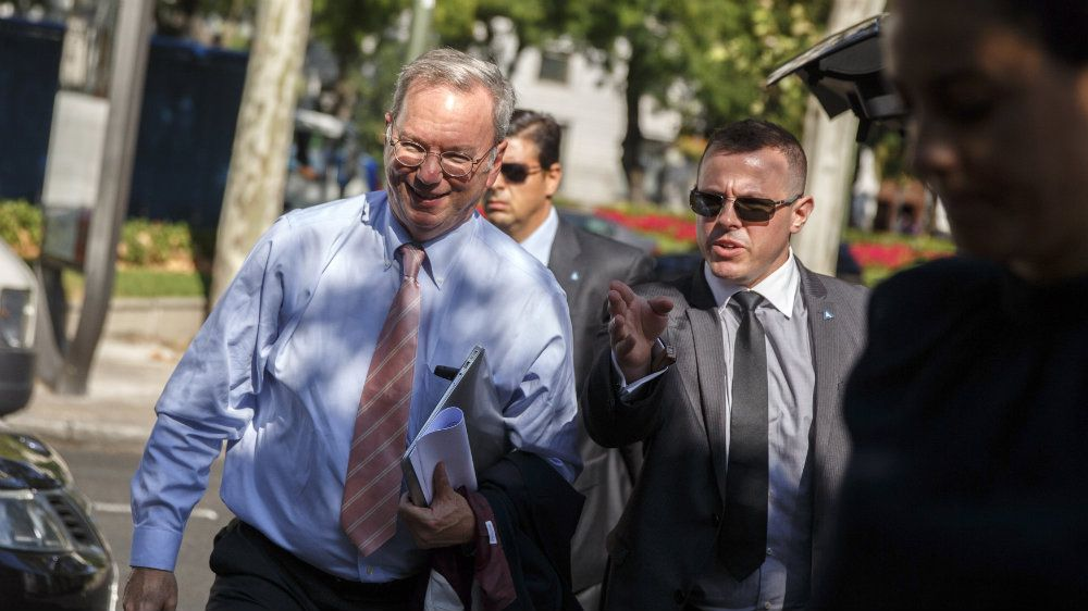 "Google Executive Chairman Eric Schmidt (L) arrives for a meeting about the ""right to be forgotten"" in Madrid September 9, 2014. A panel appointed by search engine Google will hold the first of a series of meetings on Tuesday to debate the balance between privacy and the free flow of information after a May court ruling reinforced Europeans' ""right to be forgotten"". The event in Madrid will be the first of seven meetings in European capitals, as the Internet giant struggles with thousands of requests a month to remove from its search results everything from serious criminal records, embarrassing photos, instances of online bullying and negative press stories. REUTERS/Andrea Comas (SPAIN - Tags: BUSINESS SCIENCE TECHNOLOGY SOCIETY)"