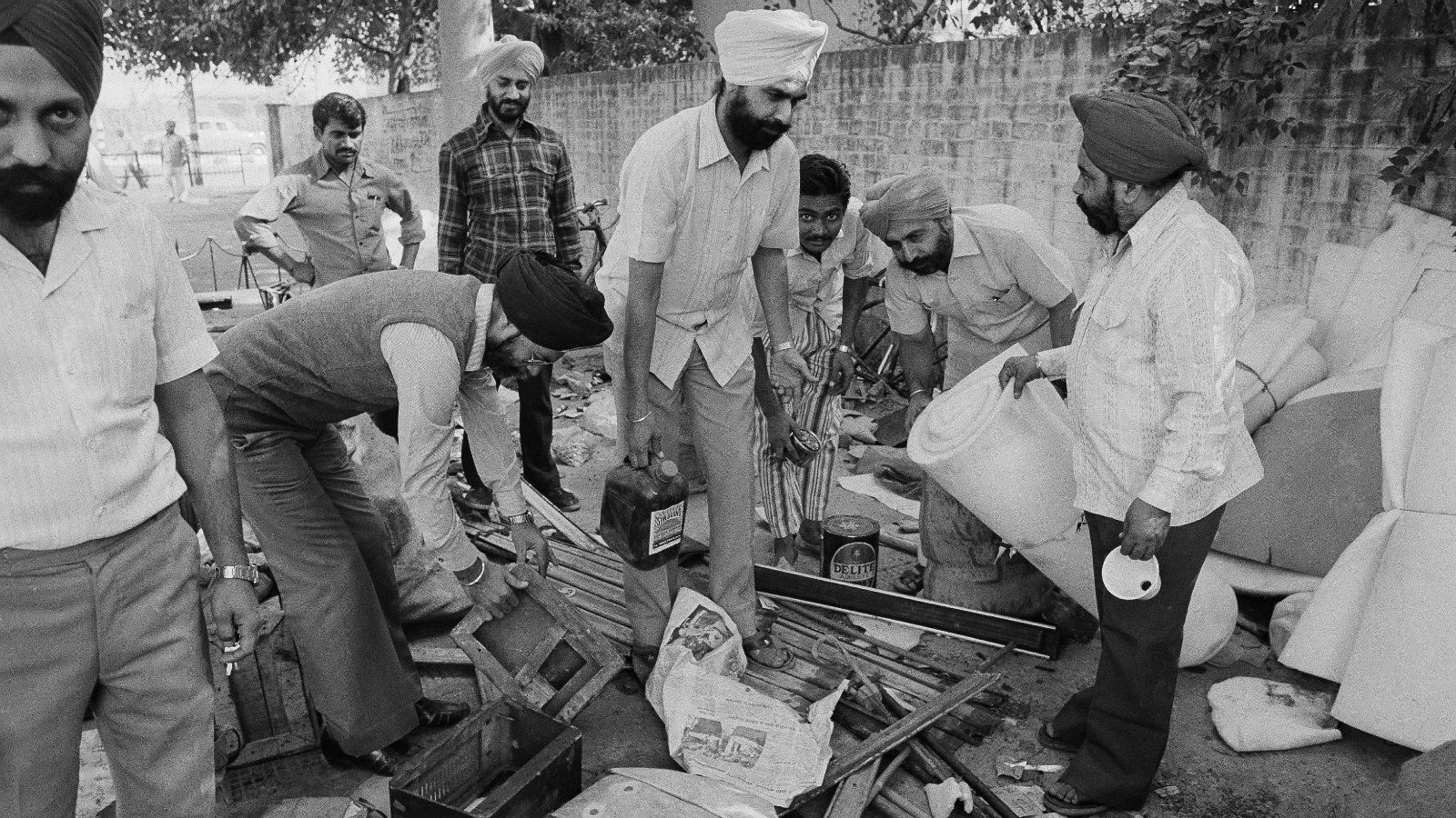 Members of the Indian Sikh community, whose house were attacked, burned and looted the past days by mobs of Hindus are seen as they collect their looted property in a Delhi police station, Nov. 6, 1984. Life is returning to normal after heavy riots that followed the assassination of Prime Minister Indira Gandhi.