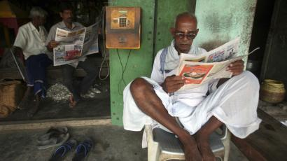 Indian man read newspaper