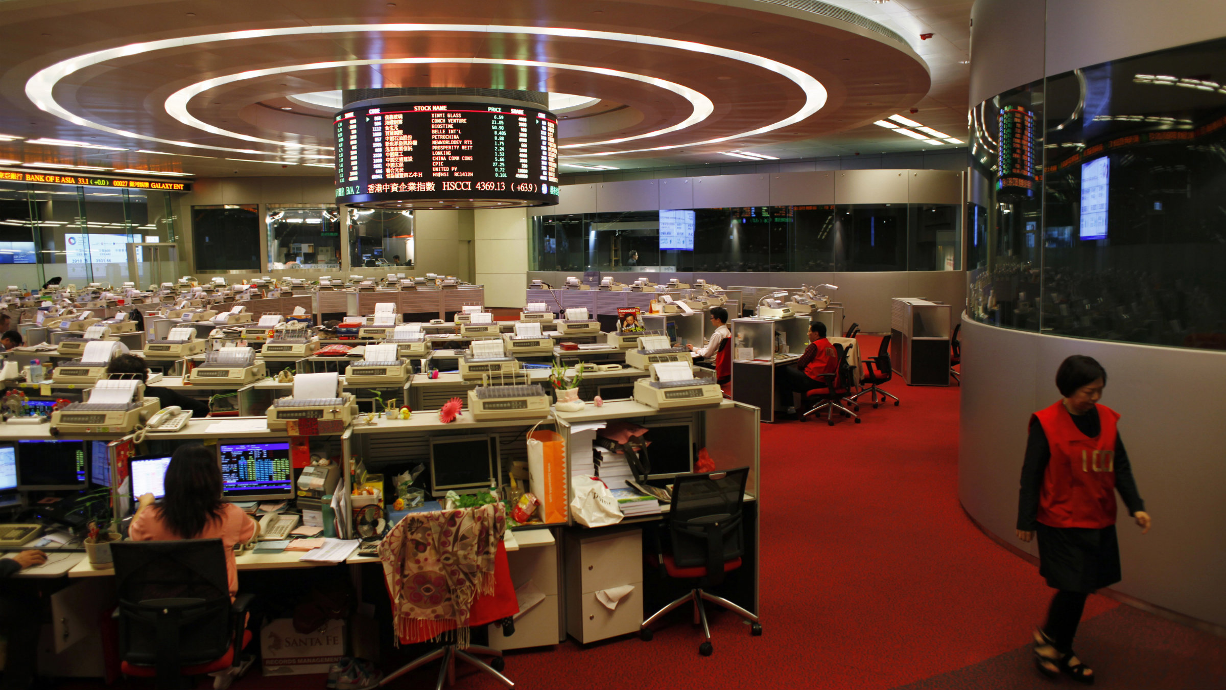 A trader walks inside the trading hall during afternoon trading at the Hong Kong Stock Exchange.