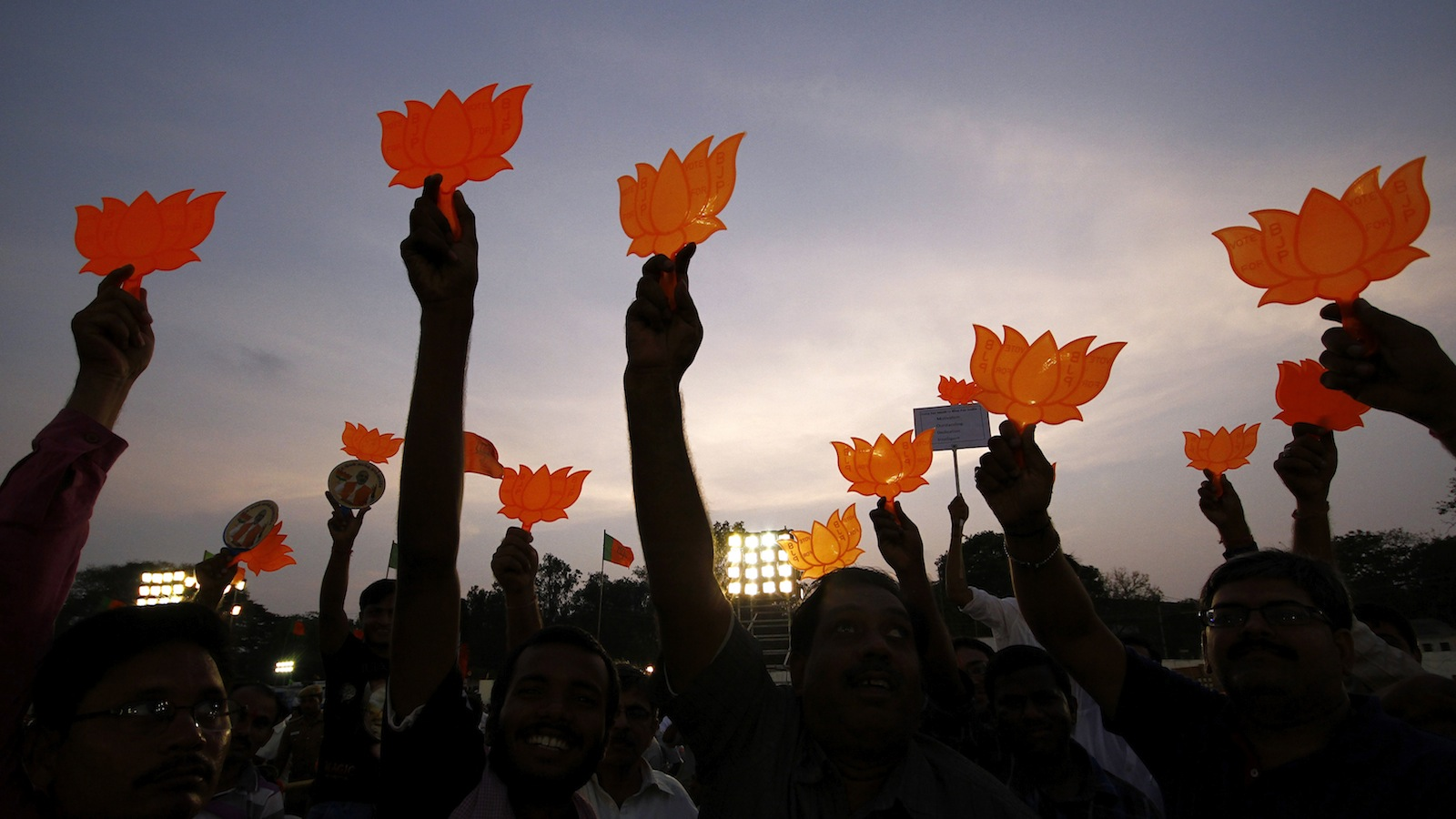 Supporters of Hindu nationalist Narendra Modi, prime ministerial candidate for India's main opposition Bharatiya Janata Party (BJP), hold the party's symbol during an election campaign rally addressed by Modi in the southern Indian city of Chennai April 13, 2014. Modi on Saturday sought to blunt criticism that he is hostile to Muslims, the country's biggest minority group. REUTERS/Babu