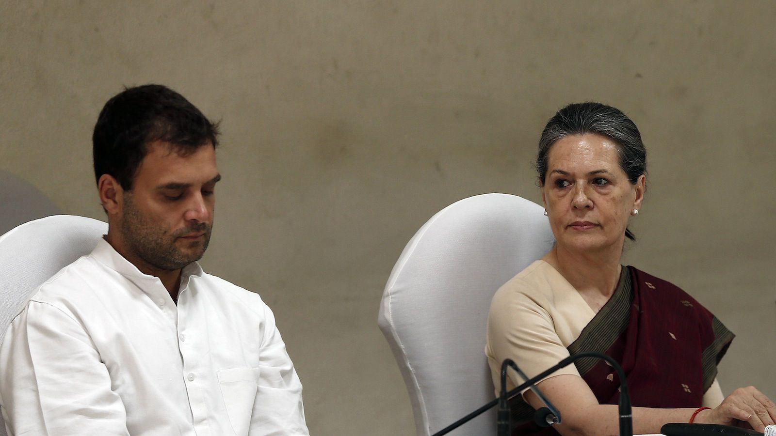 Congress party chief Sonia Gandhi (R) and her son and vice-president of Congress Rahul Gandhi attend the Congress Working Committee (CWC) meeting in New Delhi May 19, 2014. India's Congress party was preparing to rally around the Nehru-Gandhi dynasty on Monday to snuff out possible dissent after it suffered its most humiliating defeat in an election. Both party chief Sonia Gandhi and her son and heir apparent, Rahul, have accepted responsibility for the loss. Ahead of a top-level meeting, party sources said there was no question of either resigning their posts. REUTERS/Adnan Abidi (INDIA - Tags: POLITICS ELECTIONS) - RTR3PTOP