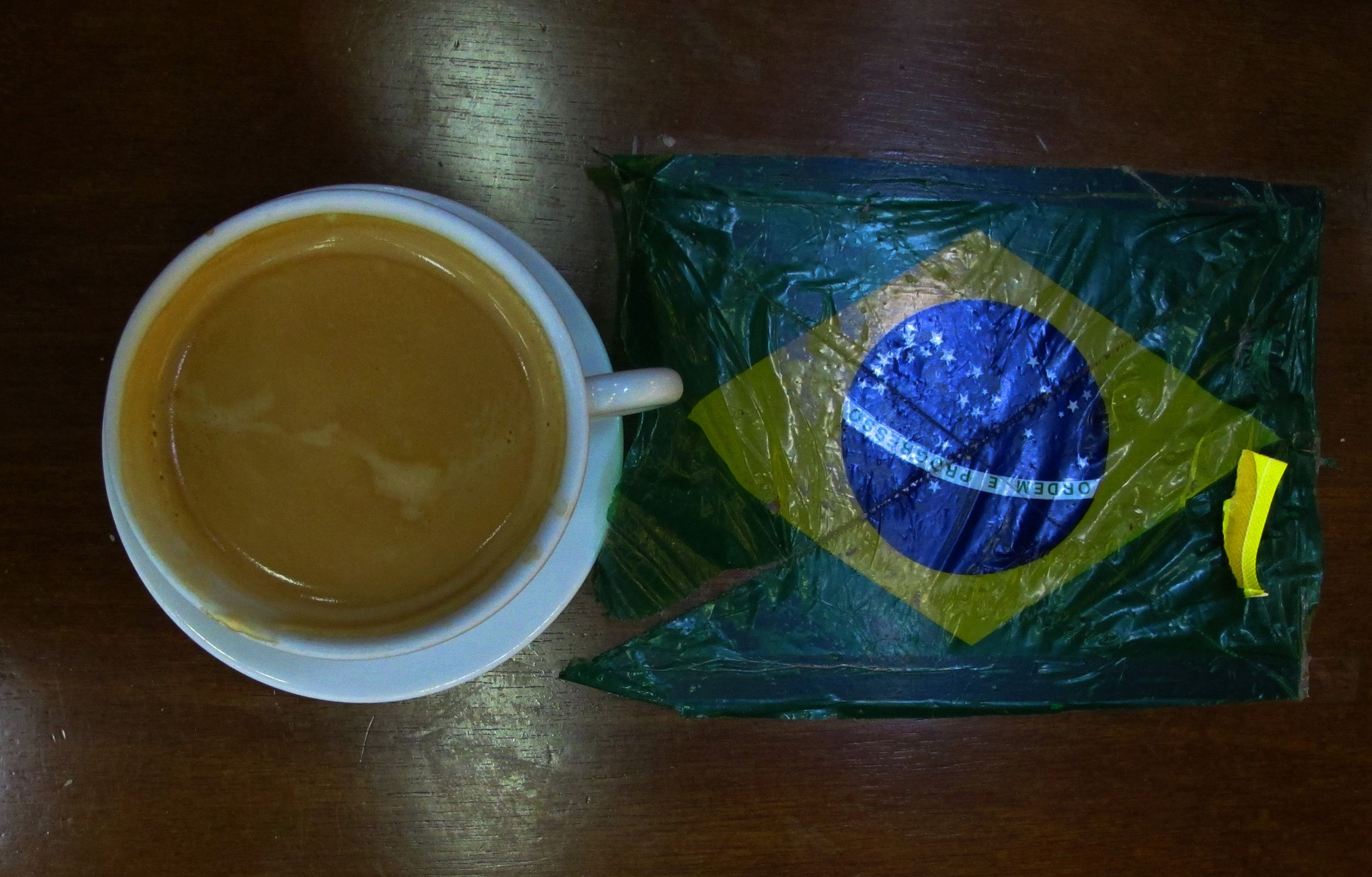 A Brazillian coffee is pictured at the International airport in Rio de Janeiro June 11, 2014. In a project called 'On The Sidelines' Reuters photographers share pictures showing their own quirky and creative view of the 2014 World Cup in Brazil. REUTERS/Michael Dalder (BRAZIL - Tags: SPORT SOCCER WORLD CUP SOCIETY) - RTR3T8NQ