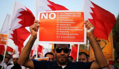 A protester holding an anti-government banner participates in a rally organised by Bahrain's main opposition party Al Wefaq in Budaiya August 8, 2014. REUTERS/Hamad I Mohammed (BAHRAIN - Tags: POLITICS CIVIL UNREST) - RTR41QHB