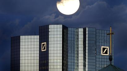 A rising full moon is seen over the distinctive twin towers of Germany's Deutsche Bank headquarters in Frankfurt.