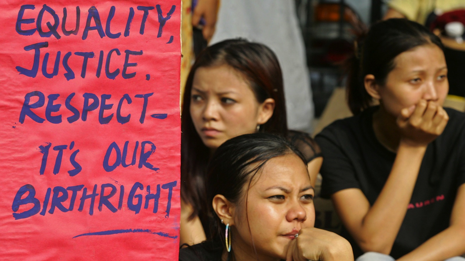 Students from North East Students Joint Action Committee (NESJAC) hold a placard during a protest in New Delhi July 25, 2005. Hundreds of students organised a protest march to challenge the stigmatized image of women and people in general from northeast India and the insecurity of women in general. REUTERS/Adnan Abidi VM/LA