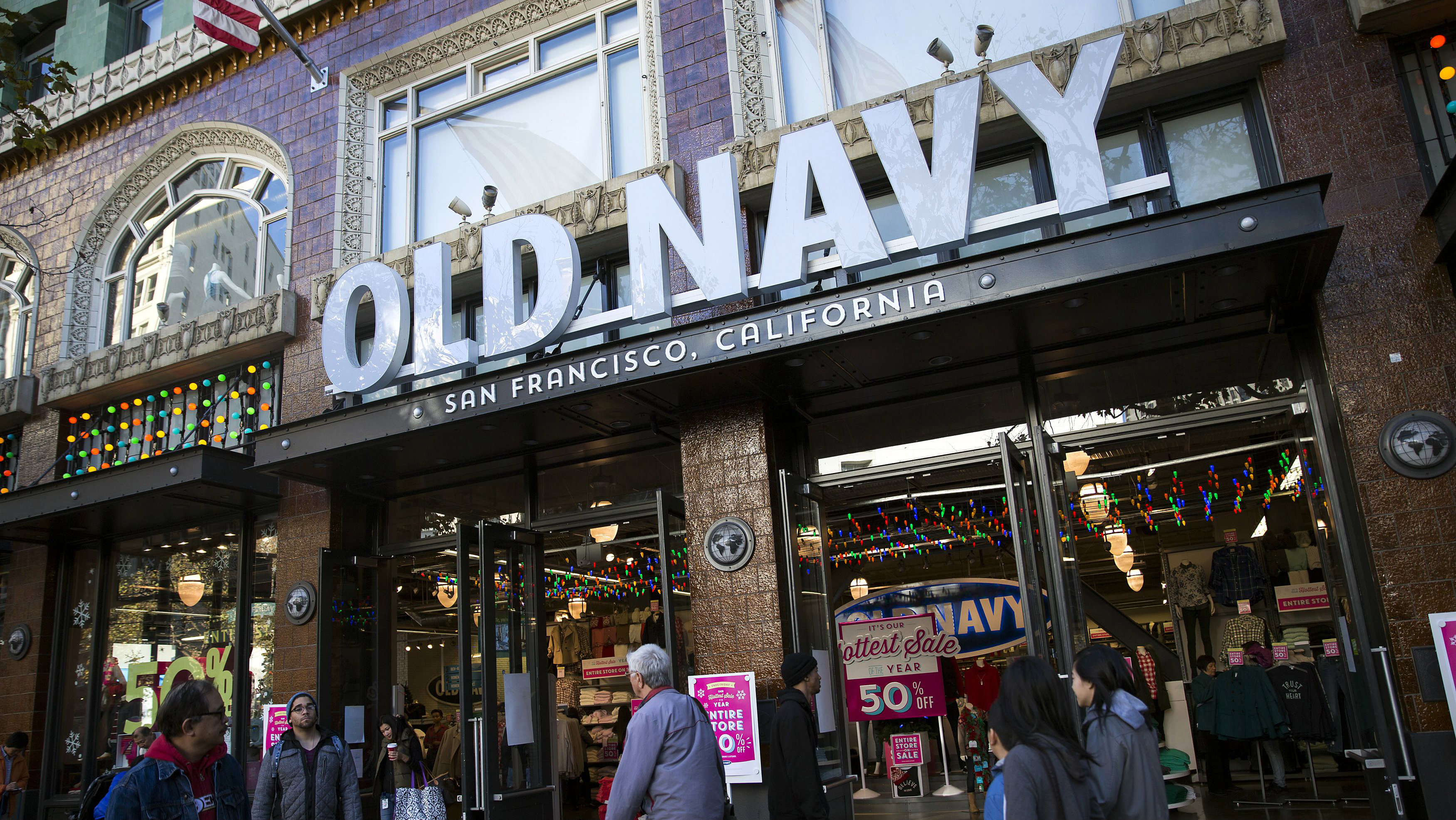 DATE IMPORTED:November 29, 2013People walk past an Old Navy store during Black Friday in San Francisco, California November 29, 2013. Black Friday, the day following the Thanksgiving Day holiday, has traditionally been the busiest shopping day in the United States. REUTERS/Stephen Lam