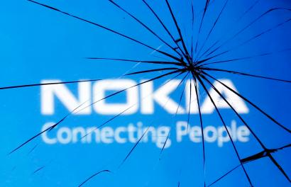 An illustration picture shows Nokia logo through a broken glass in the central Bosnian town of Zenica January 23, 2014. Nokia reported a 22 percent fall in sales at its core NSN network equipment division on January 23, 2014, highlighting the problems facing management once it completes the sale of its former flagship phones business to Microsoft for 5.4 billion euros. REUTERS/Dado Ruvic (BOSNIA AND HERZEGOVINA - Tags: BUSINESS LOGO SCIENCE TECHNOLOGY TELECOMS) - RTX17RB1