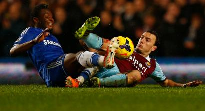 "Chelsea's John Obi Mikel (L) challenges West Ham United's Mark Noble during their English Premier League soccer match at Stamford Bridge in London, January 29, 2014. REUTERS/Eddie Keogh (BRITAIN - Tags: SPORT SOCCER) FOR EDITORIAL USE ONLY. NOT FOR SALE FOR MARKETING OR ADVERTISING CAMPAIGNS. NO USE WITH UNAUTHORIZED AUDIO, VIDEO, DATA, FIXTURE LISTS, CLUB/LEAGUE LOGOS OR ""LIVE"" SERVICES. ONLINE IN-MATCH USE LIMITED TO 45 IMAGES, NO VIDEO EMULATION. NO USE IN BETTING, GAMES OR SINGLE CLUB/LEAGUE/PLAYER PUBLICATIONS - RTX18088"