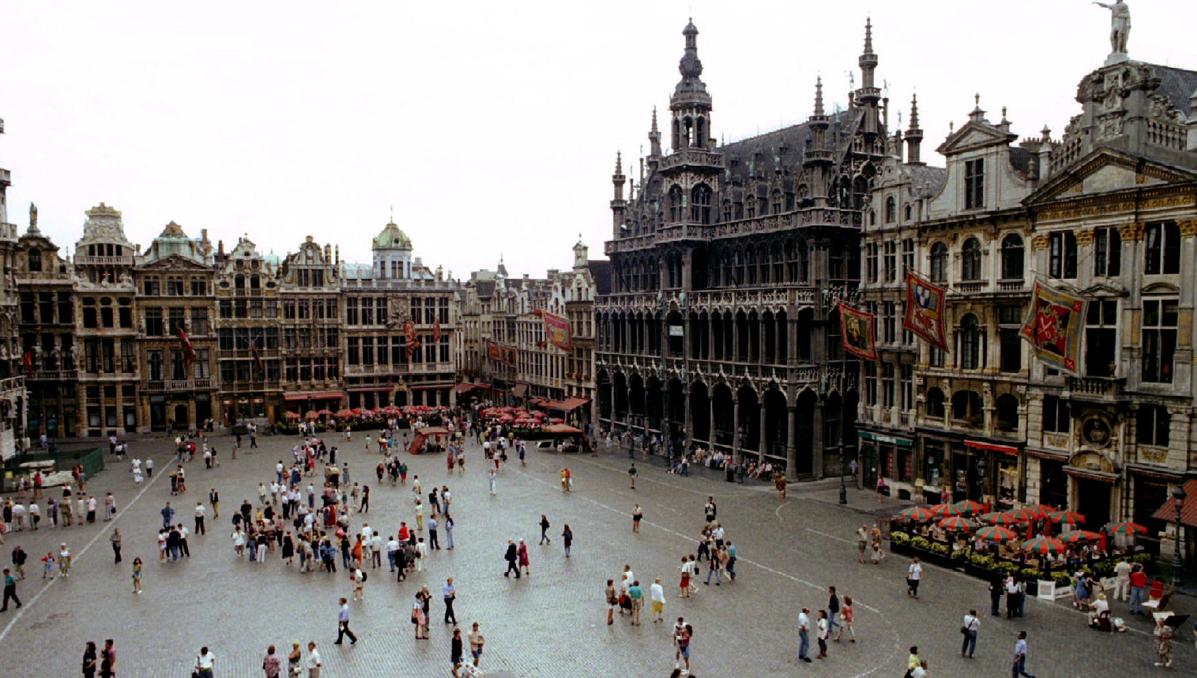 An aerial view of people walking through the Brussels Grand' Place. The city of Brussels commemorates on Aug 15 the 300th anniversary of French bombardment, which set the city ablaze and led to the creation of the Grand' Place. The bombardment destroyed most of the old town, but the square was rebuilt in three years in the exuberant Italo-Flemish baroque style that stands virtually unchanged today - RTXFTC9