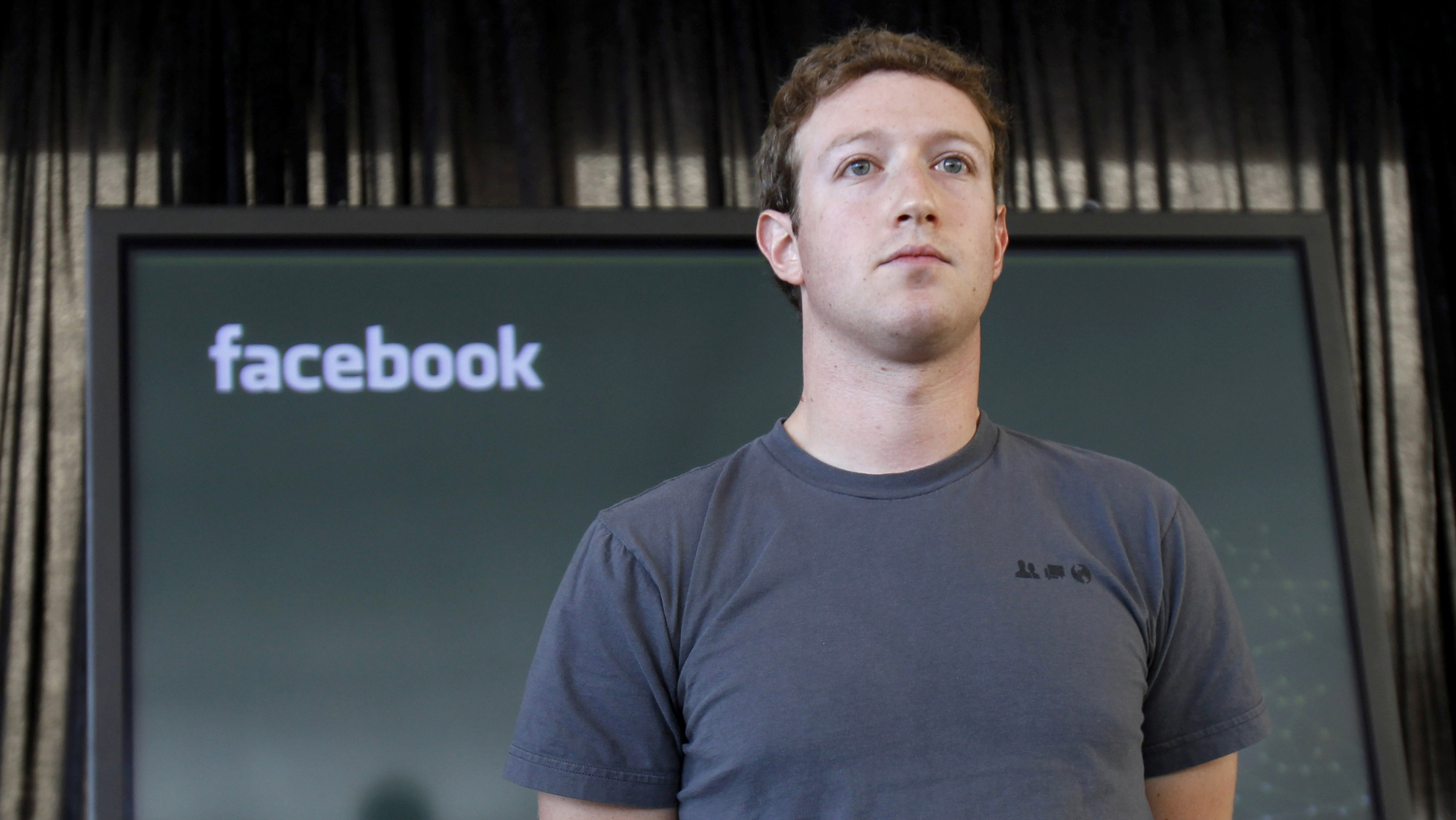 Facebook CEO Mark Zuckerberg listens to a question from the audience after unveiling a new messaging system during a news conference in San Francisco.