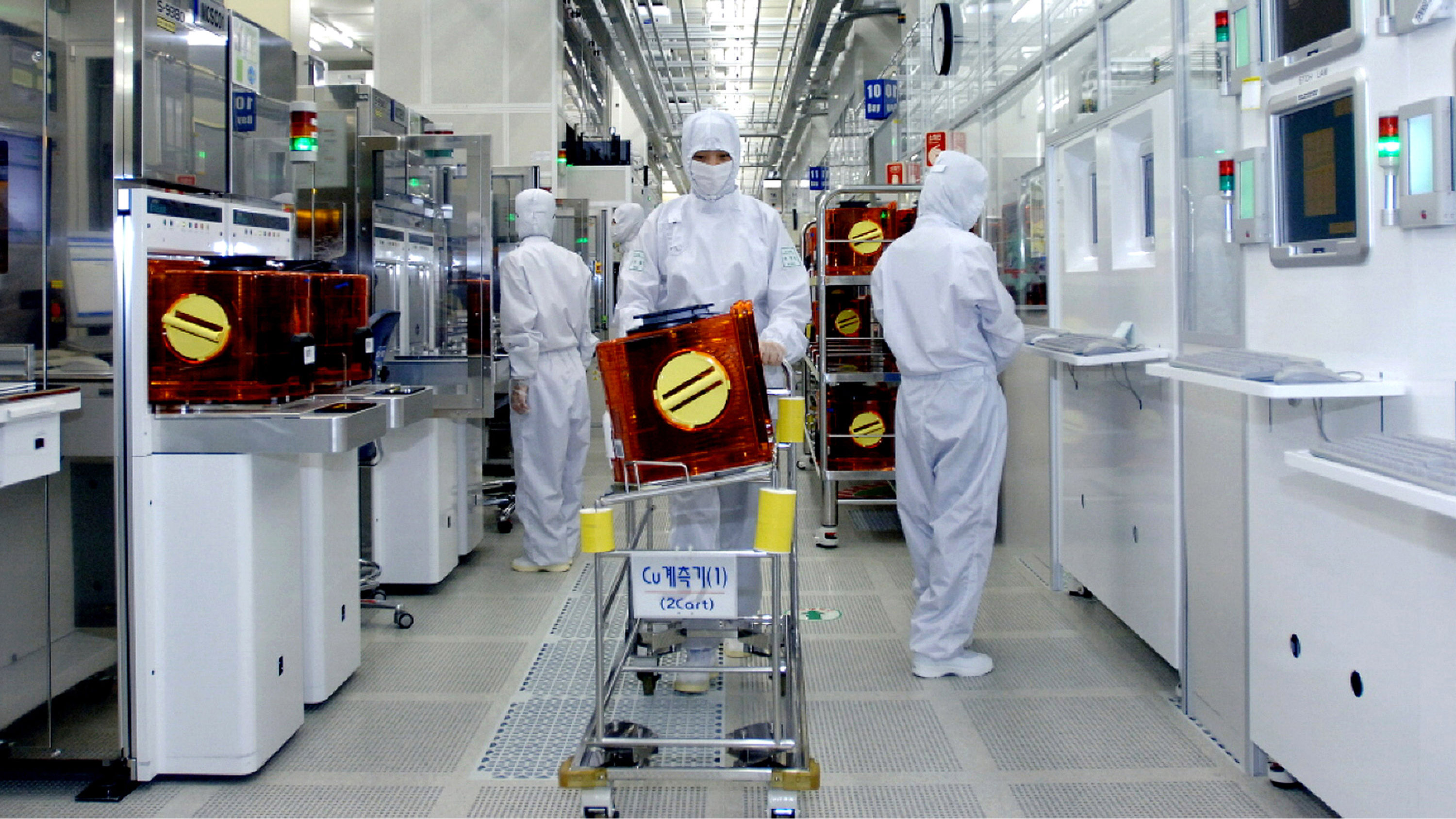 South Korean employees of Samsung Electronics Co. work at the resumed assembly line at semiconductor plant in Suwon, south of Seoul, Monday, Aug. 6, 2007.