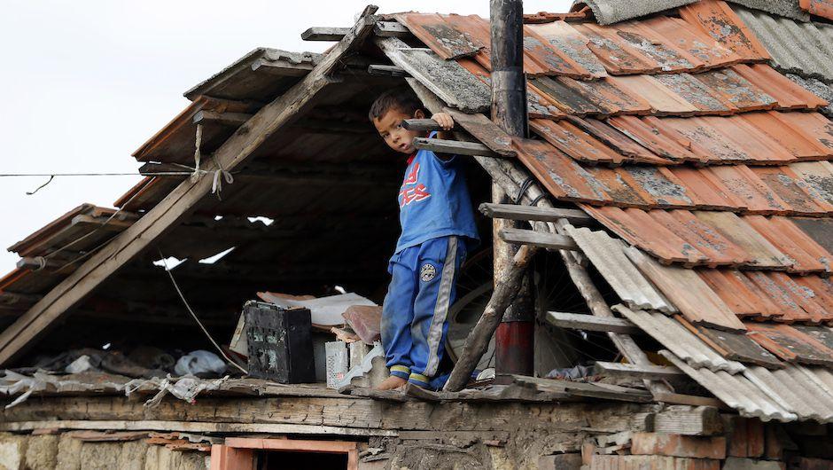 Roma child plays in the attic of a house in a slum in Tiszavasvari