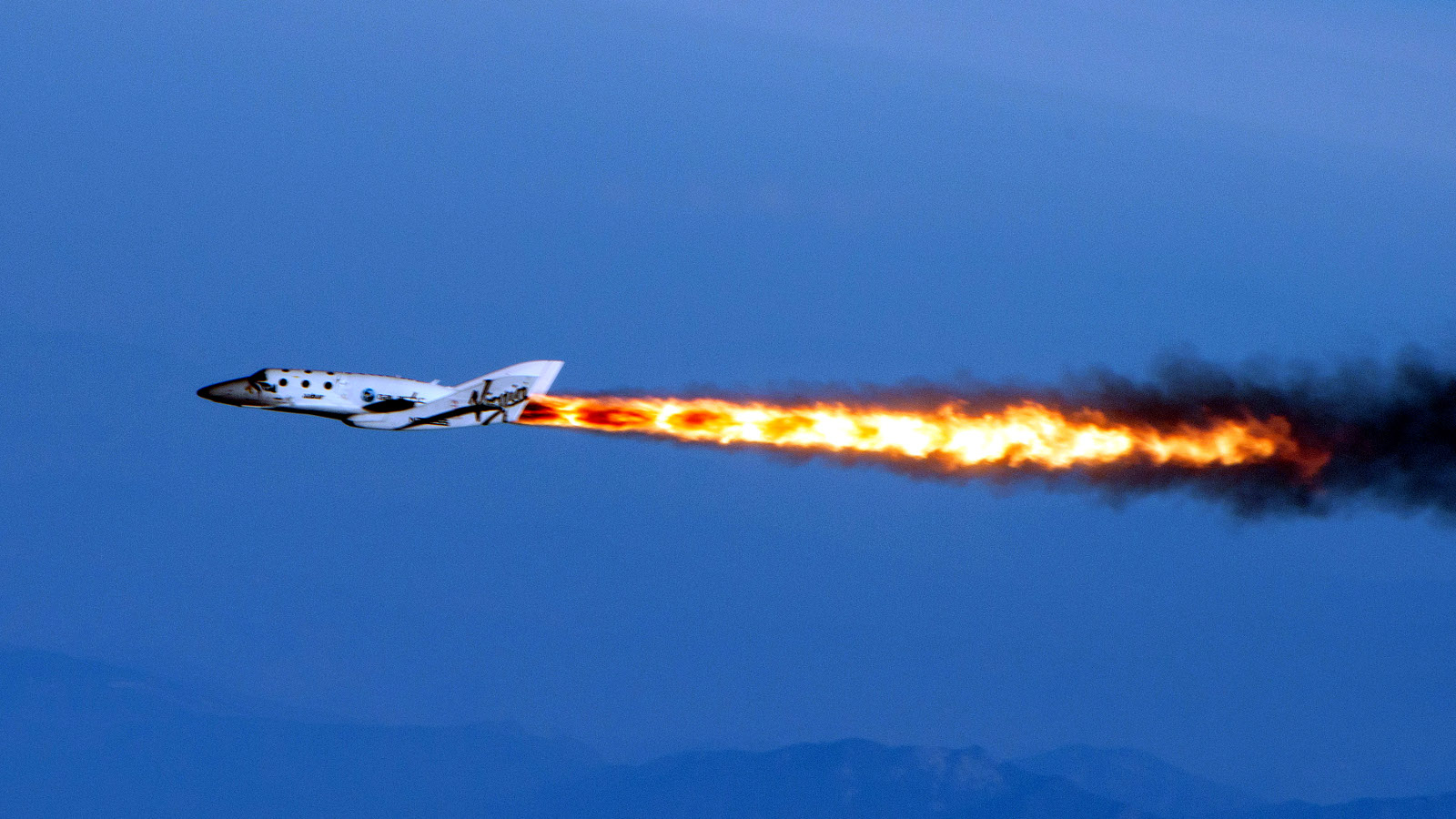 ADVANCE FOR WEEKEND MEMBER EXCHANGE.; FOR SUNDAY, FEB. 9 - FILE - This April 29, 2013 file photo provided by Virgin Galactic shows Virgin Galactic's SpaceShipTwo under rocket power, over Mojave, Calif. The rise of commercial space raises questions about the future of Houston as Space City, which for the entire history of U.S. spaceflight has been responsible for training and managing the flights of U.S. astronauts.