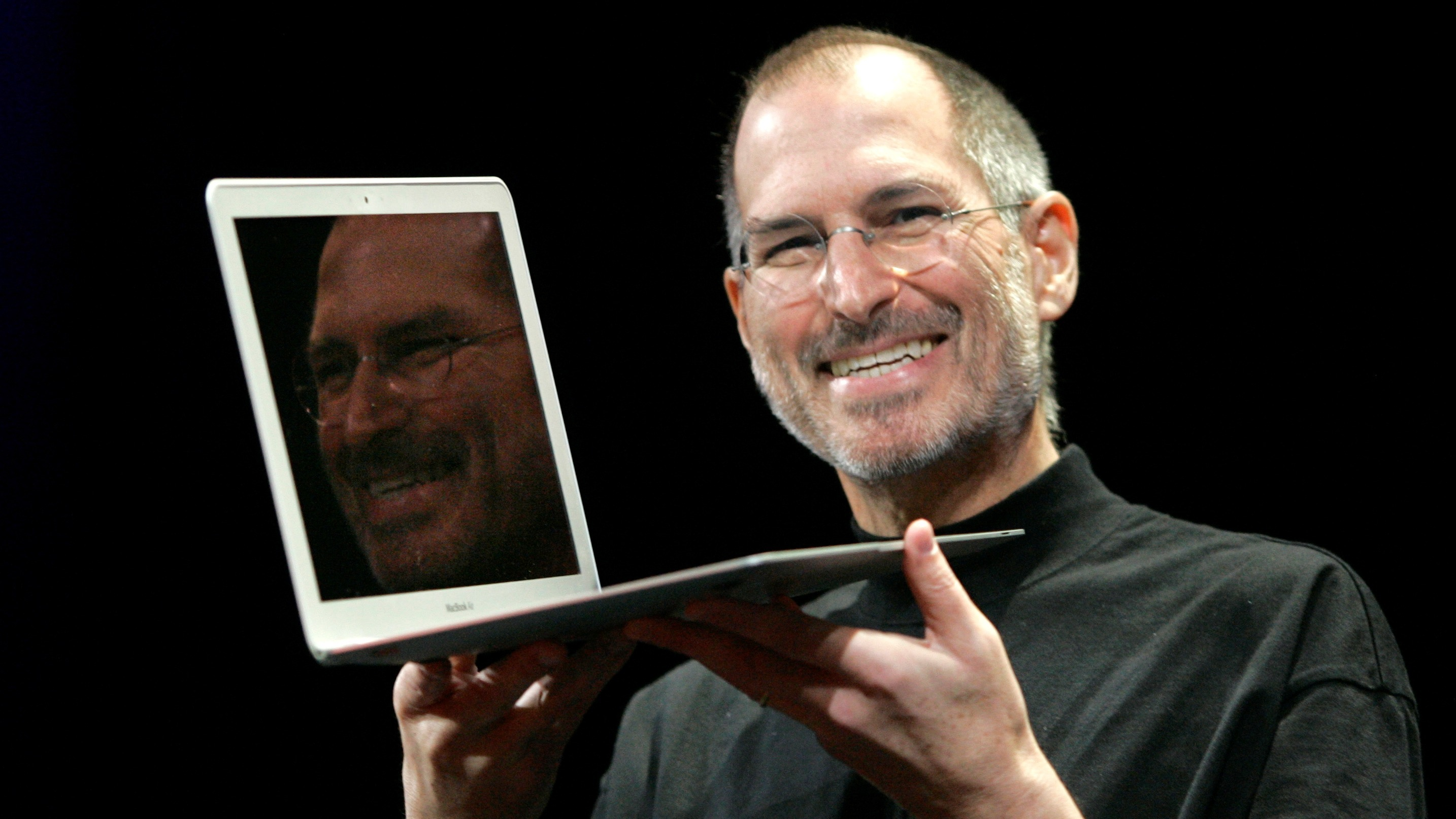 Apple CEO Steve Jobs holds up the new MacBook Air while giving the keynote address at Apple MacWorld Conference in San Francisco, Tuesday, Jan. 15, 2008. The super-slim new laptop is less than an inch thick and turns on the moment it's opened. (AP Photo/Jeff Chiu)