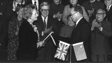 British prime minister Margaret Thatcher and Chinese premier Zhao Ziyang exchange signed copies of the Hong Kong handover agreement in Beijing on Dec. 19, 1984.