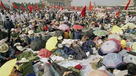 Beijing University students relax in Tiananmen Square as their hunger strike for democracy begins a fourth day on Tuesday, May 16, 1989.
