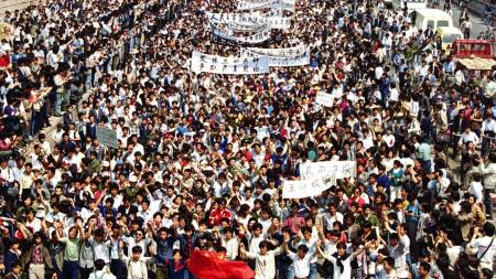 Thousands of students from local colleges and universities march to Tiananmen Square on May 4, 1989.