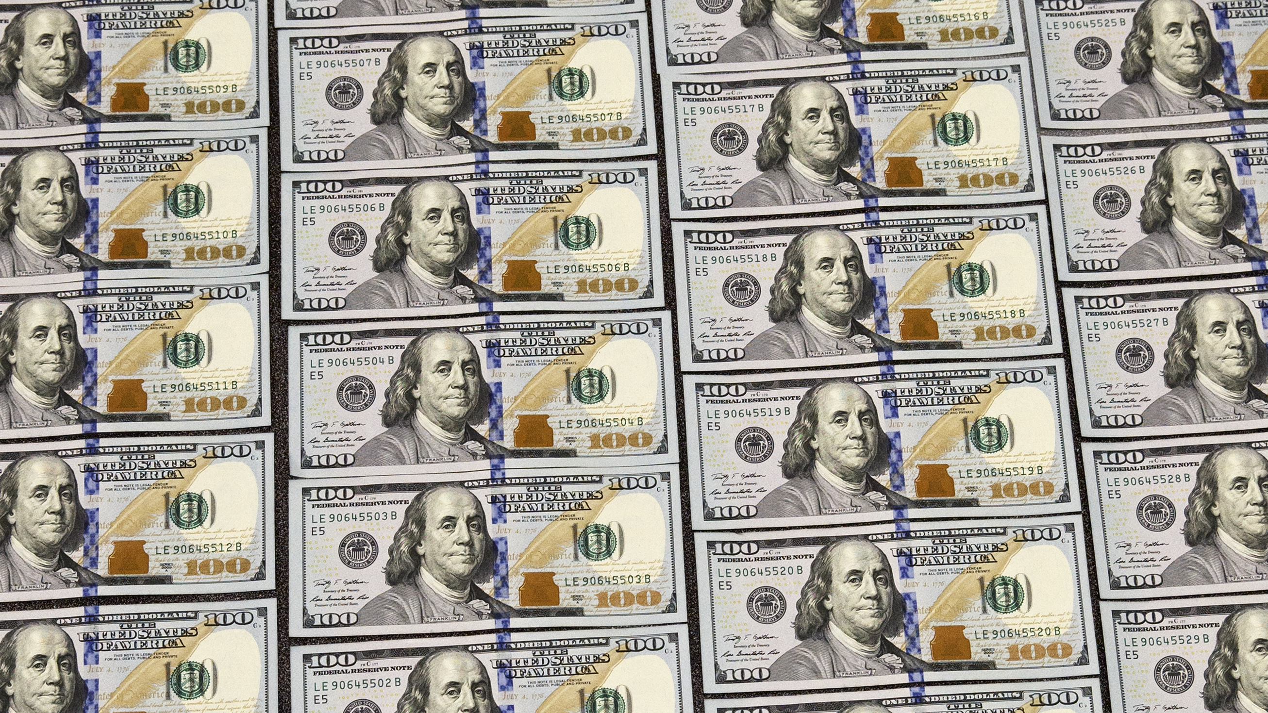 U.S. currency in one hundred dollar denominations are displayed for illustration purposes, in Washington, Monday, March 31, 2014. (AP Photo/J. Scott Applewhite)