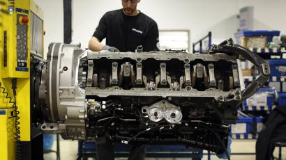 In this March 26, 2014 picture, Jon Wyand works on a truck engine assembly line at Volvo Trucks' powertrain manufacturing facility in Hagerstown, Md. Recent goods news on manufacturing and hiring has boosted confidence in the economy. Manufacturing is expanding at a healthy pace and the service industry continues to grow, according to surveys released by the Institute for Supply Management earlier this month. (AP Photo/Patrick Semansky)