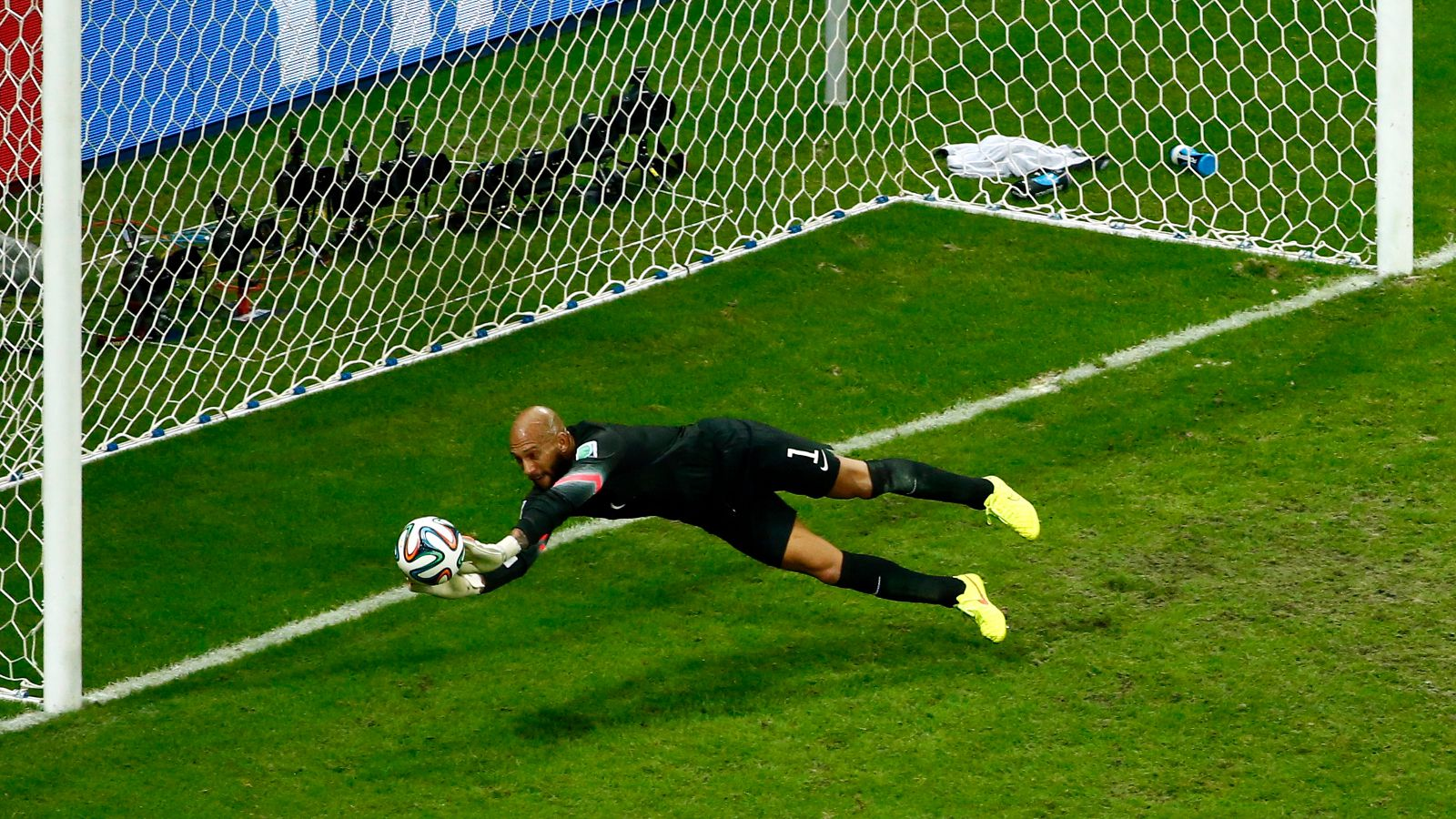 Goalkeeper Tim Howard of the U.S. saves a shot during their 2014 World Cup round of 16 game against Belgium at the Fonte Nova arena in Salvador July 1, 2014