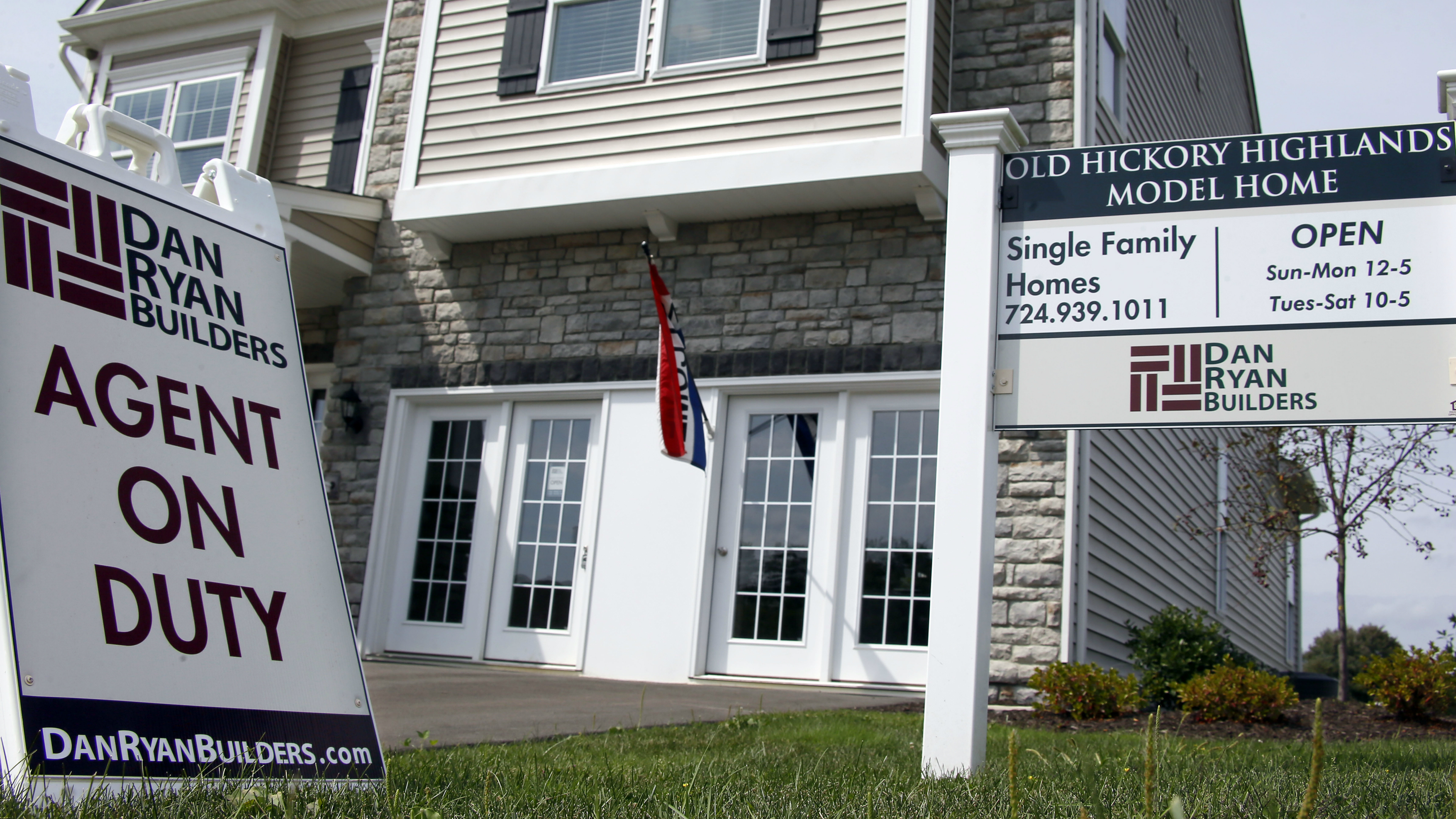 In this photo made on Wednesday, Sept. 10, 2014, signs welcome visitors to a model home as construction is under way at a housing development in Zelienople, Pa. Real estate date provider CoreLogic releases its August report on U.S. home prices on Tuesday, Oct. 7, 2014. (AP Photo/Keith Srakocic)
