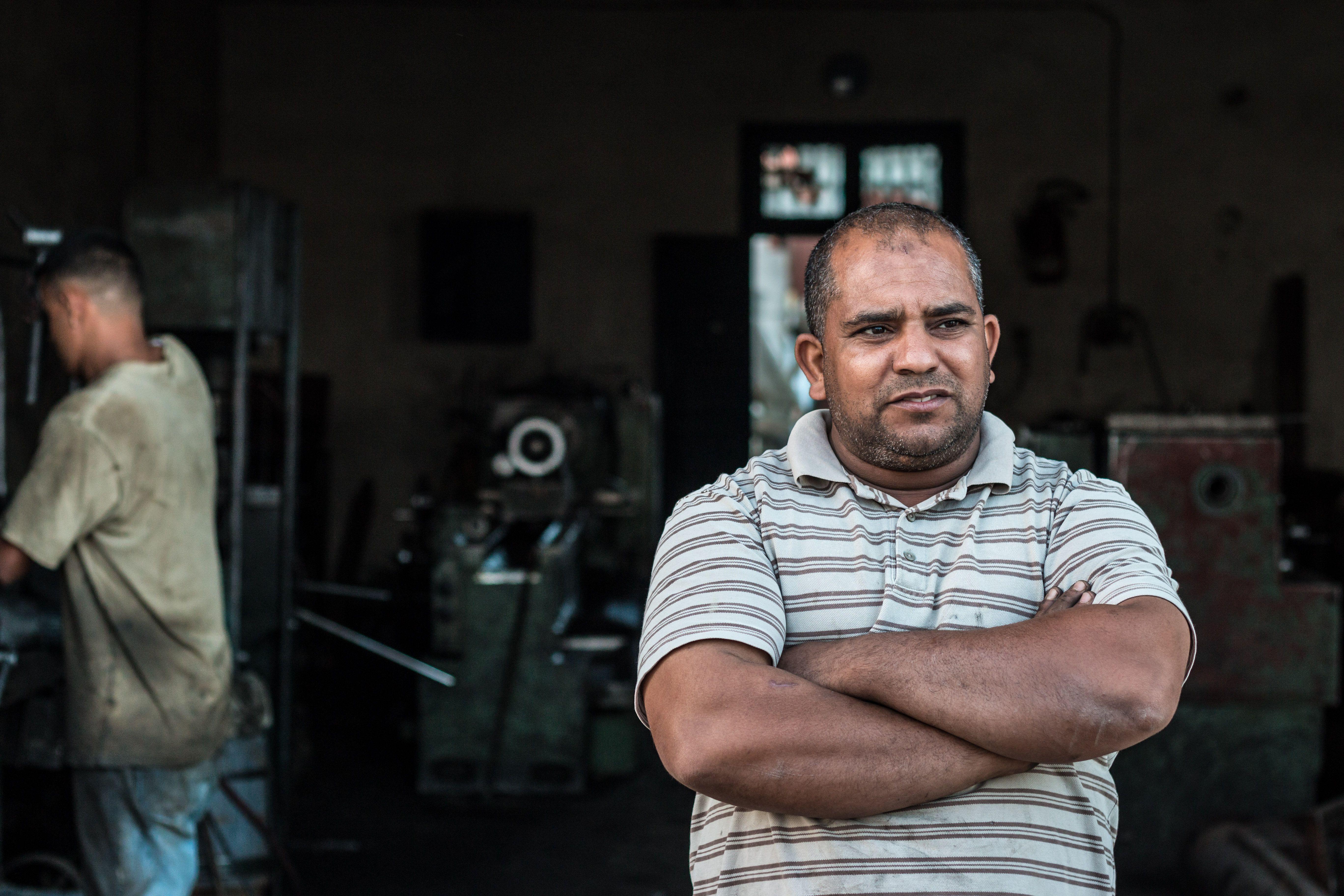 Ibrahim outside his car repair shop