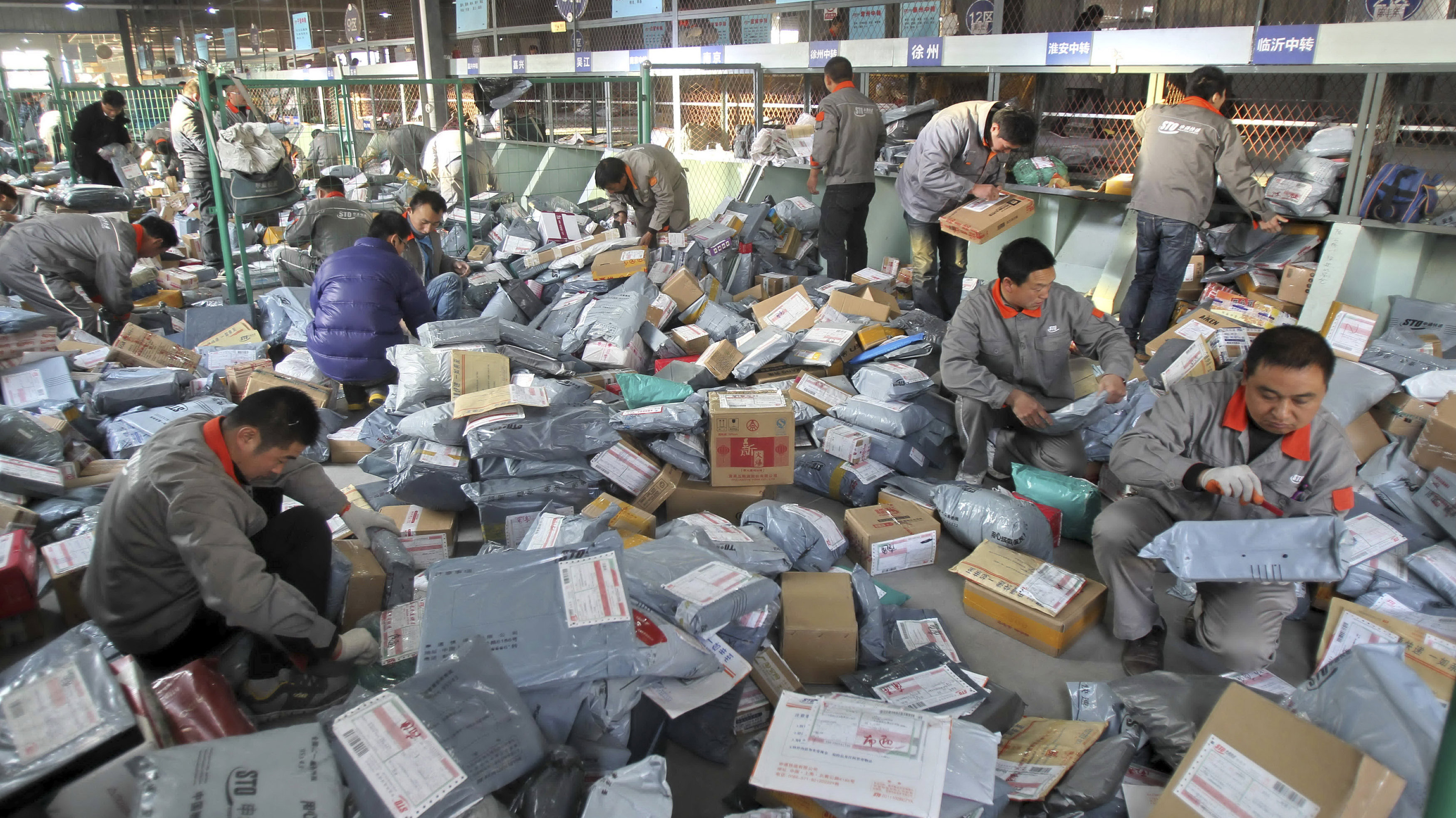 Employees sort packages at a hub of an express delivery company in Nantong, Jiangsu province.