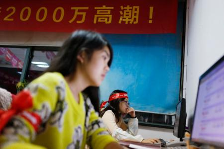 Employees of a Tmall, which sells underwear on Alibaba, work online to serve customers and deal with orders overnight in Hangzhou, early November 11, 2014. Alibaba Group Holding Ltd said about $2 billion worth of goods were sold on the e-commerce giant's websites within the first hour and 12 seconds of its annual shopping festival. REUTERS/Aly Song (CHINA - Tags: BUSINESS EMPLOYMENT) - RTR4DNI3