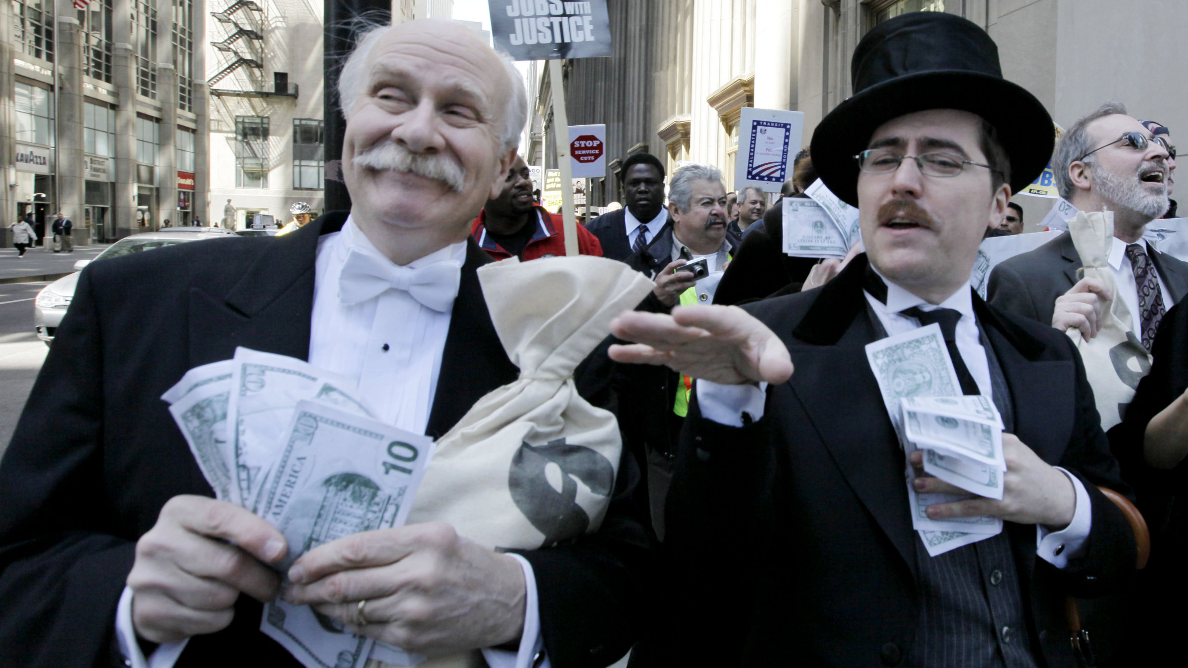Protesters dressed as Wall Street bankers, march from Goldman Sachs' office to a rally in Chicago's Federal Plaza demanding Wall Street reform.