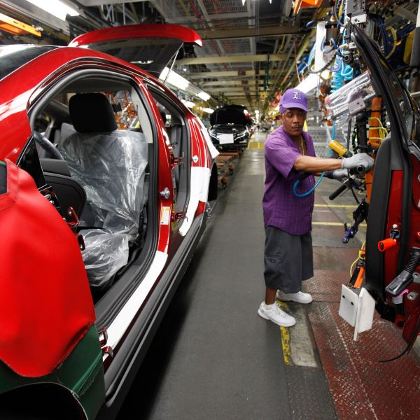 In this July 27, 2011 photo, assembly line worker Edward Houie moves a door into position for a Chevrolet Volt at the General Motors Hamtramck Assembly plant in Hamtramck, Mich. Factory orders rose in July, helped by increased demand for autos and commercial aircraft Wednesday, Aug. 31, 2011. (AP Photo/Paul Sancya)