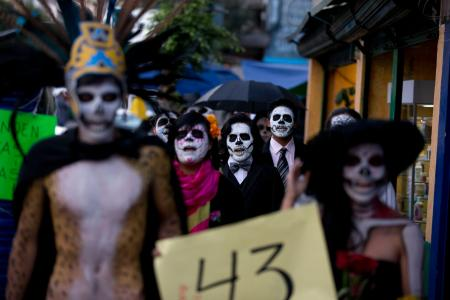 Students march on Mexico's Day of the Dead