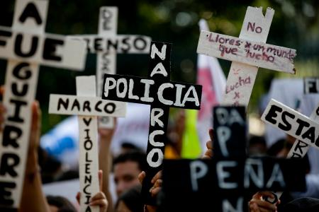 "Demonstrators protest against ""narco cops"" in Mexico City."