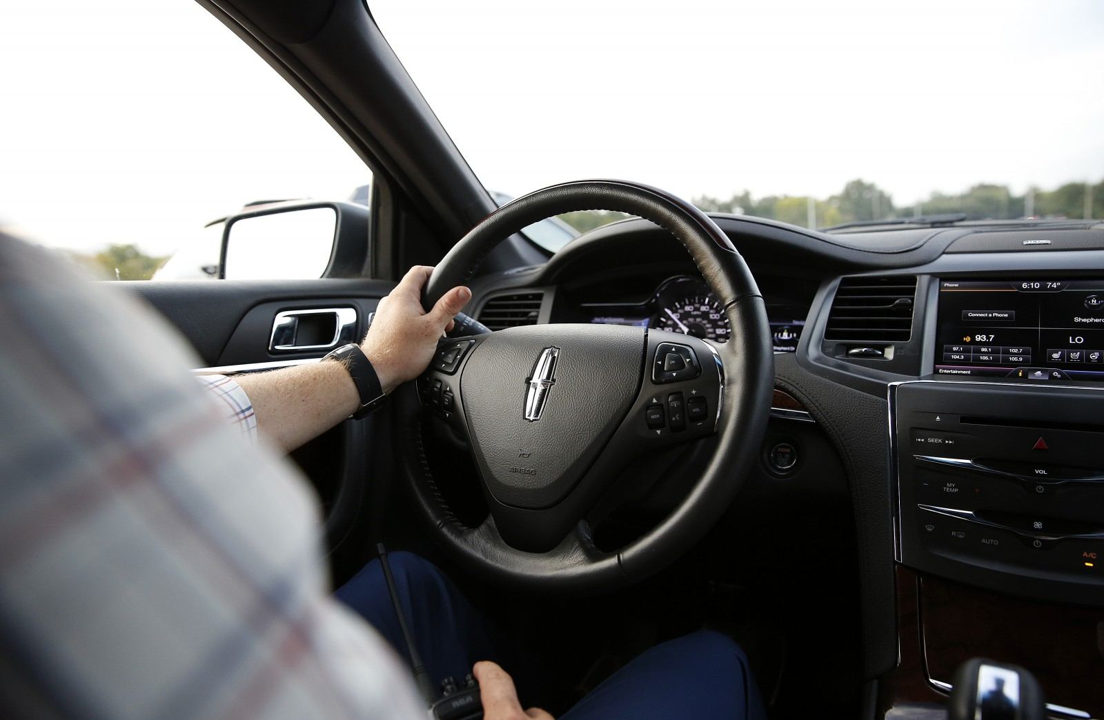 """A person drives the 2013 Lincoln MKZ at the """"Hello, Again"""" City Tour on Tuesday, Oct. 29, 2013 in Houston. (Photo by Aaron M. Sprecher/Invision for Lincoln/AP Images)"""