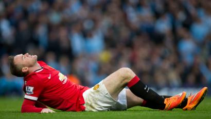 Manchester United's Wayne Rooney reacts after a missed opportunity during his team's English Premier League soccer match against Manchester City at the Etihad Stadium, Manchester, England, Sunday Nov. 2, 2014. (AP Photo/Jon Super)