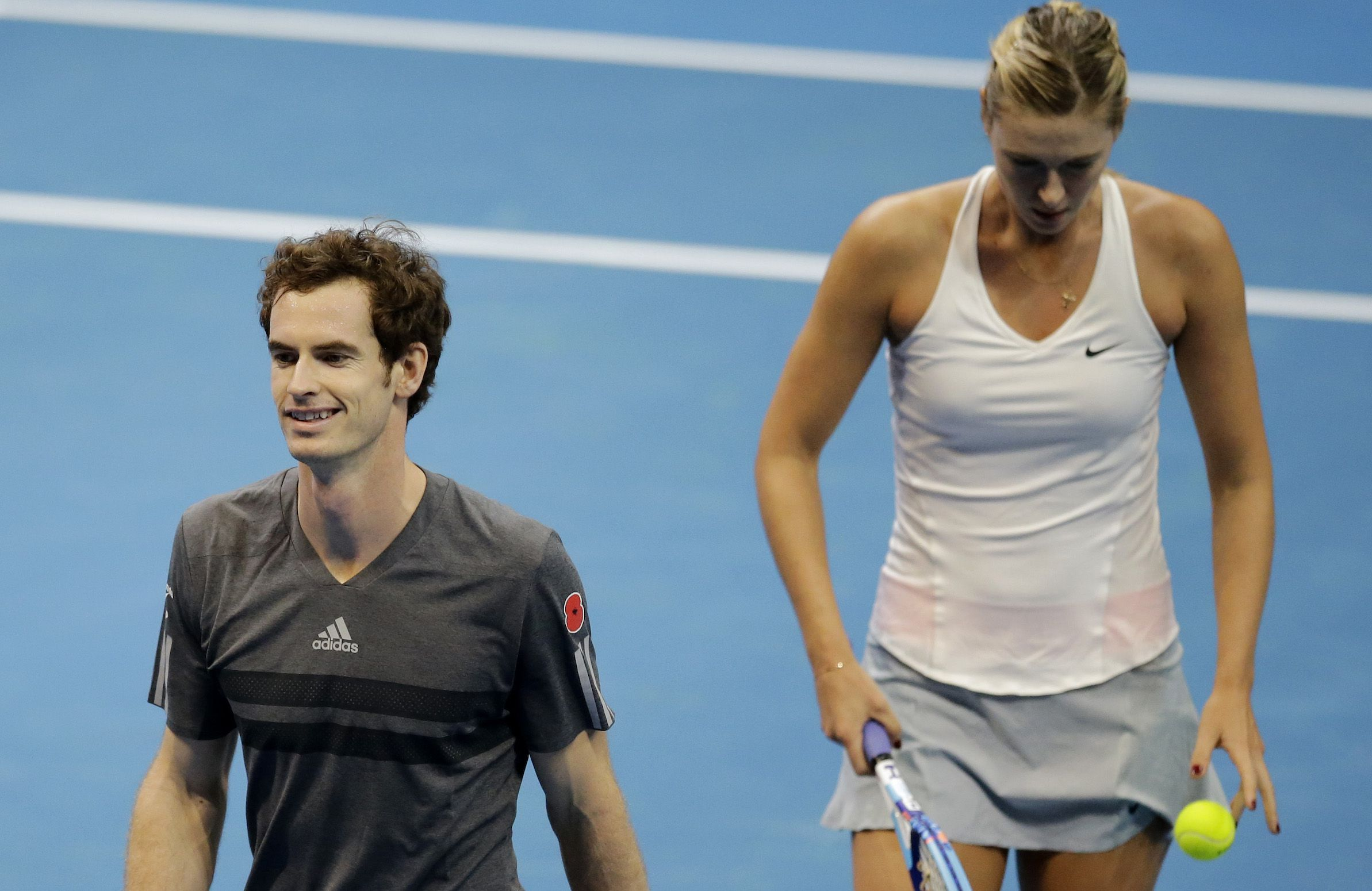 Andy Murray, left, and Maria Sharapova of the Manila Mavericks walk to their bench after losing to Kristina Mladenovic and Nenad Zimonji of the UAE Royals, during their IPTL (International Premier Tennis League) Mixed Doubles match Friday, Nov. 28, 2014 at the Mall of Asia Arena at suburban Pasay city, south of Manila, Philippines. The IPTL, featuring four teams, introduces a new format in tennis and a chance for a championship prize of $1-million dollars. (AP Photo/Bullit Marquez)