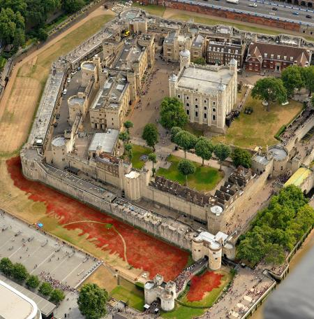 "A sea of red ceramic poppies which form part of an art installation to commemorate World War I is seen in the dry moat of the Tower of London in London, Monday, Aug. 4, 2014. The installation of 888,246 ceramic poppies by ceramic artist Paul Cummins and entitled ""Blood Swept Lands and Seas of Red"" will be unveiled on August 5 to mark the centenary of World War I, with the final one being planted on Armistice Day on November 11. Each poppy represents a British military fatality from World War I. (AP Photo/Rob Taggart)"