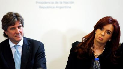 Argentina's President Cristina Fernandez (R) and Vice-President Amado Boudou attend a ceremony at the Casa Rosada presidential palace in Buenos Aires April 12, 2012. The shares of Argentina's biggest energy company, YPF SA, closed 7.4 percent higher on Thursday ahead of an expected government takeover of the company. Some local media say Fernandez will make an announcement on Thursday evening regarding YPF's future, but government officials did not confirm this.