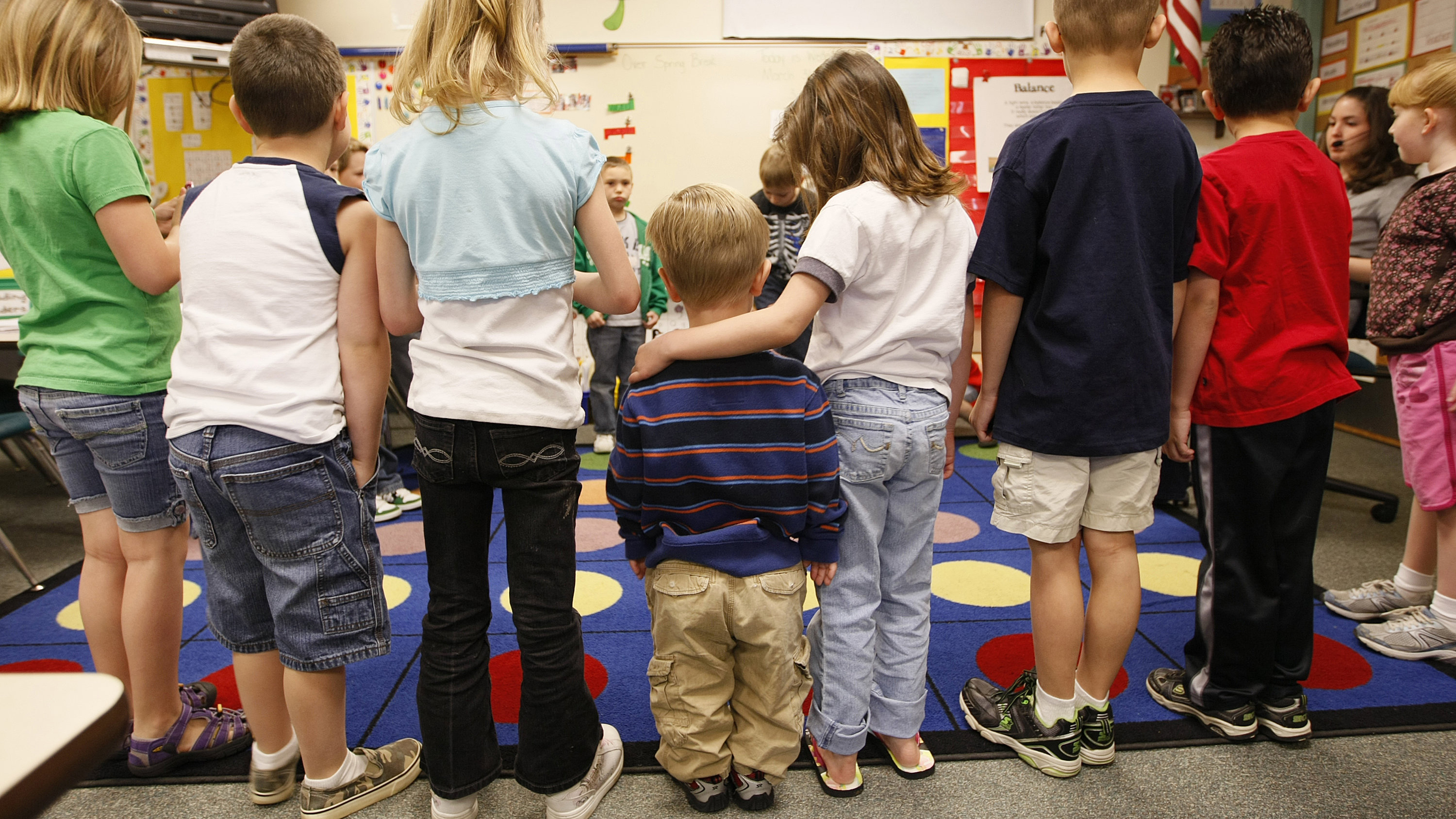 First grader Adam Kotzian (C) does a spelling drill with classmates in his classroom at Eagleview Elementary school in Thornton, Colorado March 31, 2010. Adam and his parents are achondroplastic dwarfs but his sister Avery is not. Like many people with dwarfism, the Kotzians have worked hard to overcome social and physical barriers to lead full and normal lives which includes working with non-profit group, Little People of America (LPA), to stop people treating them like a circus act.  To match Reuters-Life! story LIFE-DWARFISM/