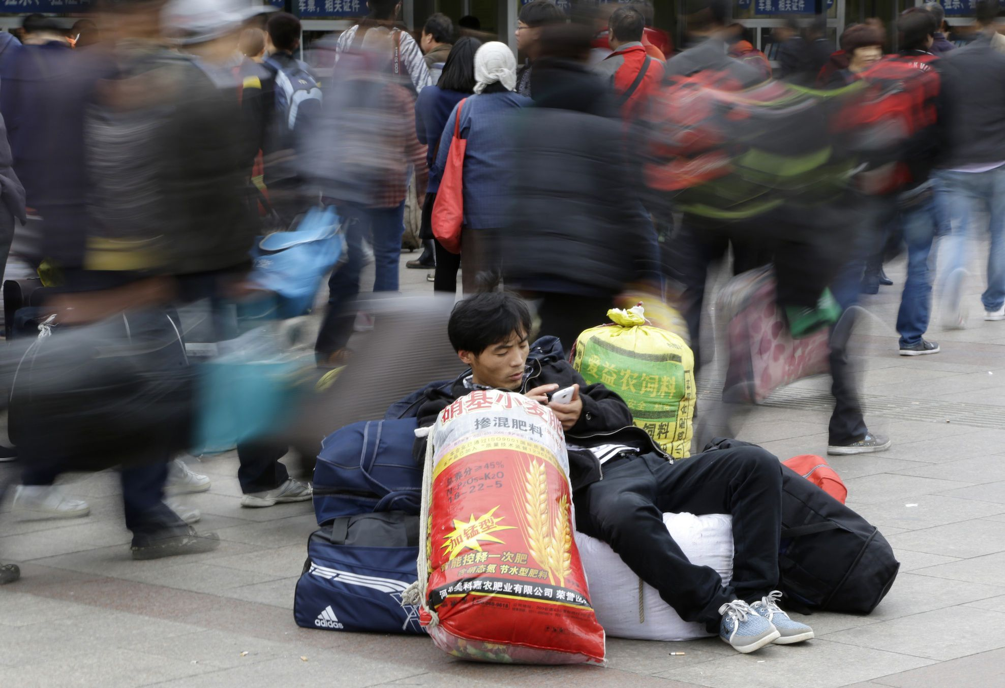 chinese worker on cell phone web