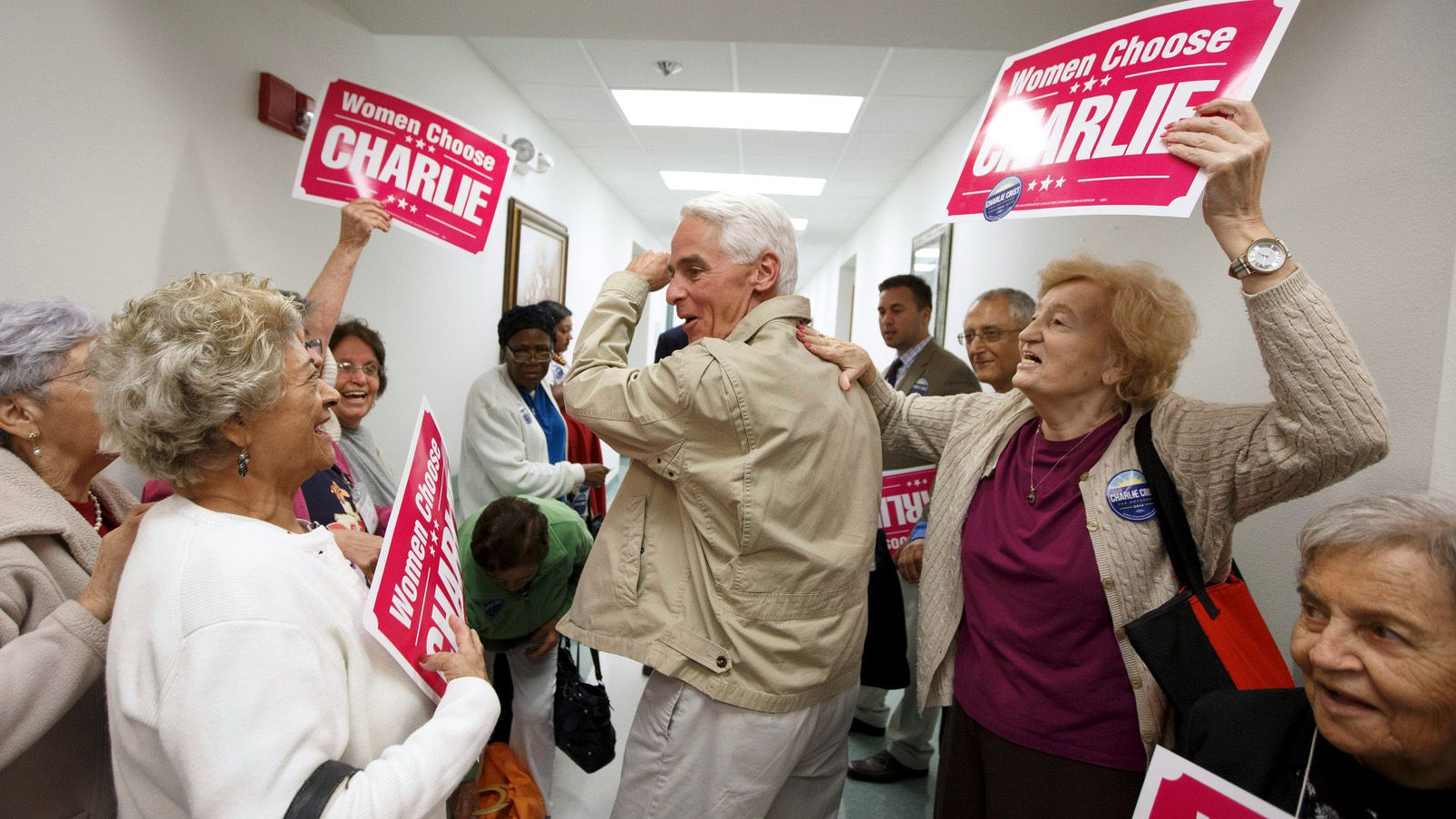 Former Florida Governor and Democratic gubernatorial candidate Charlie Crist (C) heads out of the Mid-County Senior Center, during a four-city bus campaign tour in Lake Worth, Florida November 3, 2014. Florida Republican Governor Rick Scott and Crist remain statistically tied in their bitterly fought campaign, according to a poll released on Monday, the eve of Election Day.