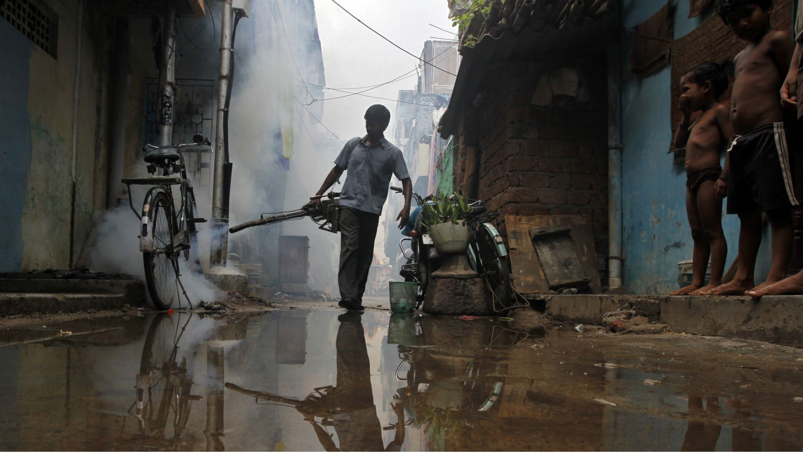 A Chennai Corporation worker fumigates a residential area in the southern Indian city of Chennai October 25, 2012. Chennai Corporation conducted fumigation of the residential areas to prevent the spread of dengue, a mosquito-transmitted virus that causes a fever which can be deadly, the corporation's officials said.