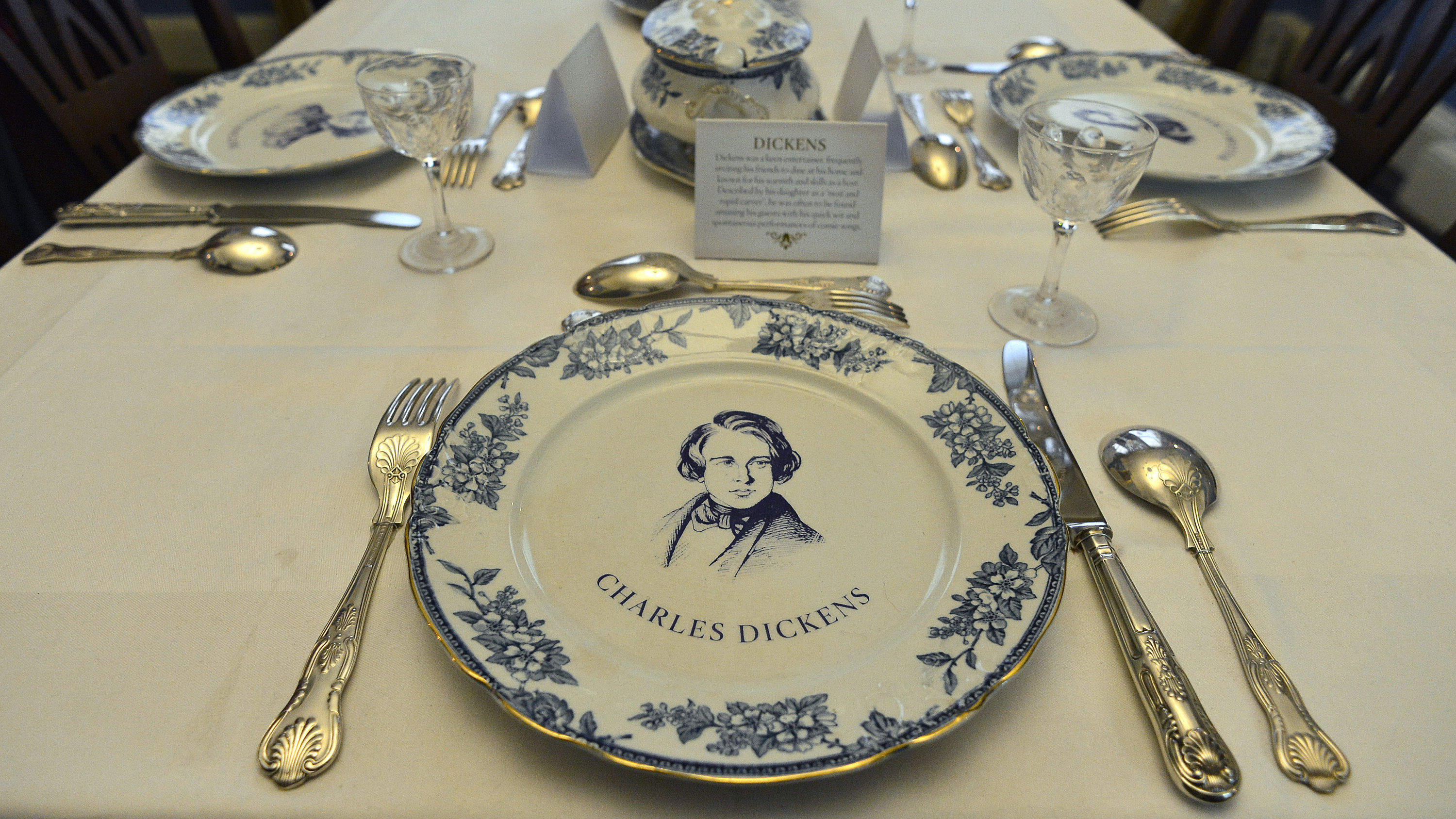 The laid table is seen in the dining room of the Charles Dickens Museum in central London December 10, 2012. The former London home of Charles Dickens reopened on Monday, after an eight-month, 3.1 million GBP ($5 million) refurbishment celebrating the author's bicentenary.