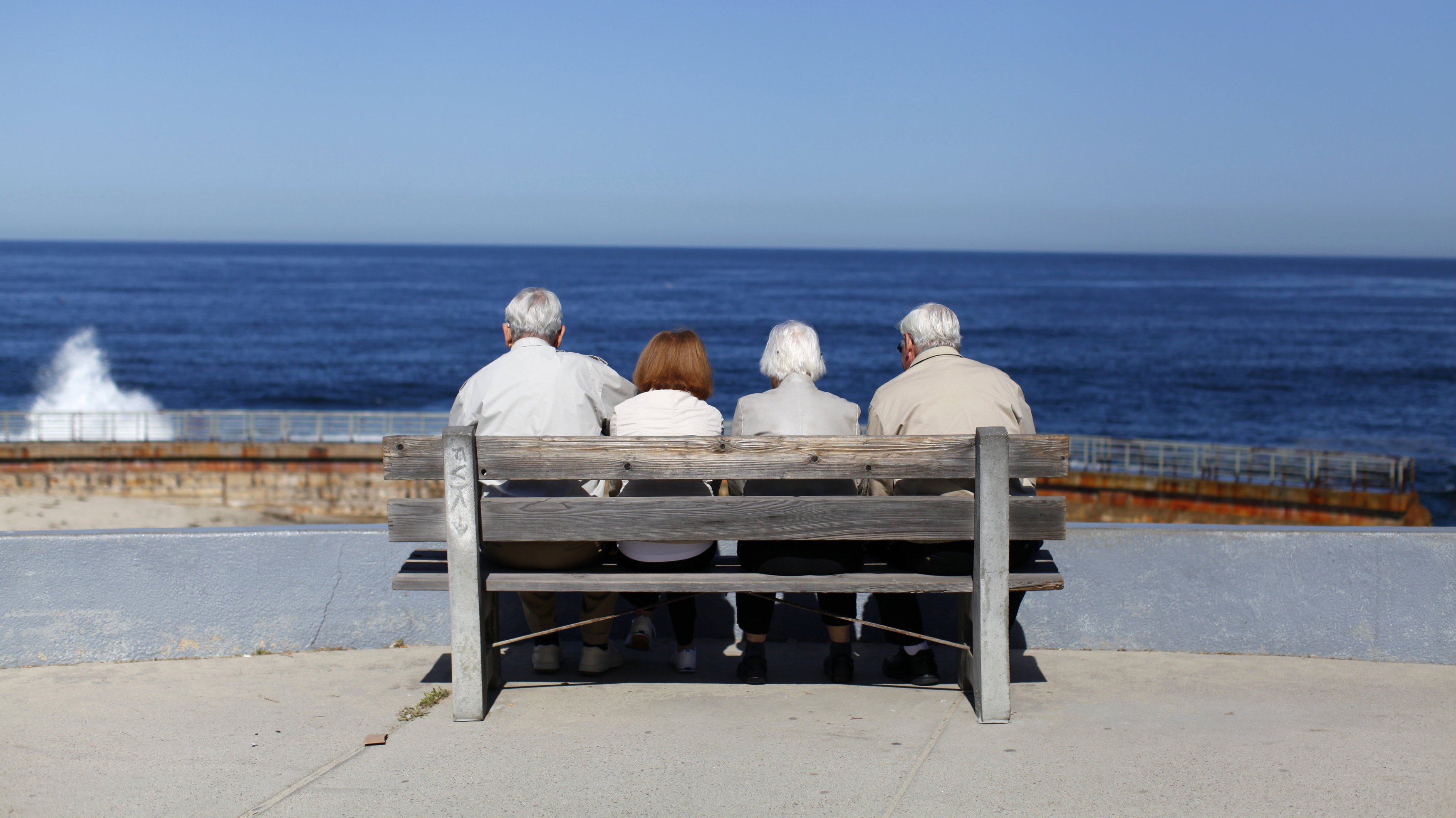 A pair of elderly couples view the ocean and waves along the beach in La Jolla, California March 8, 2012.