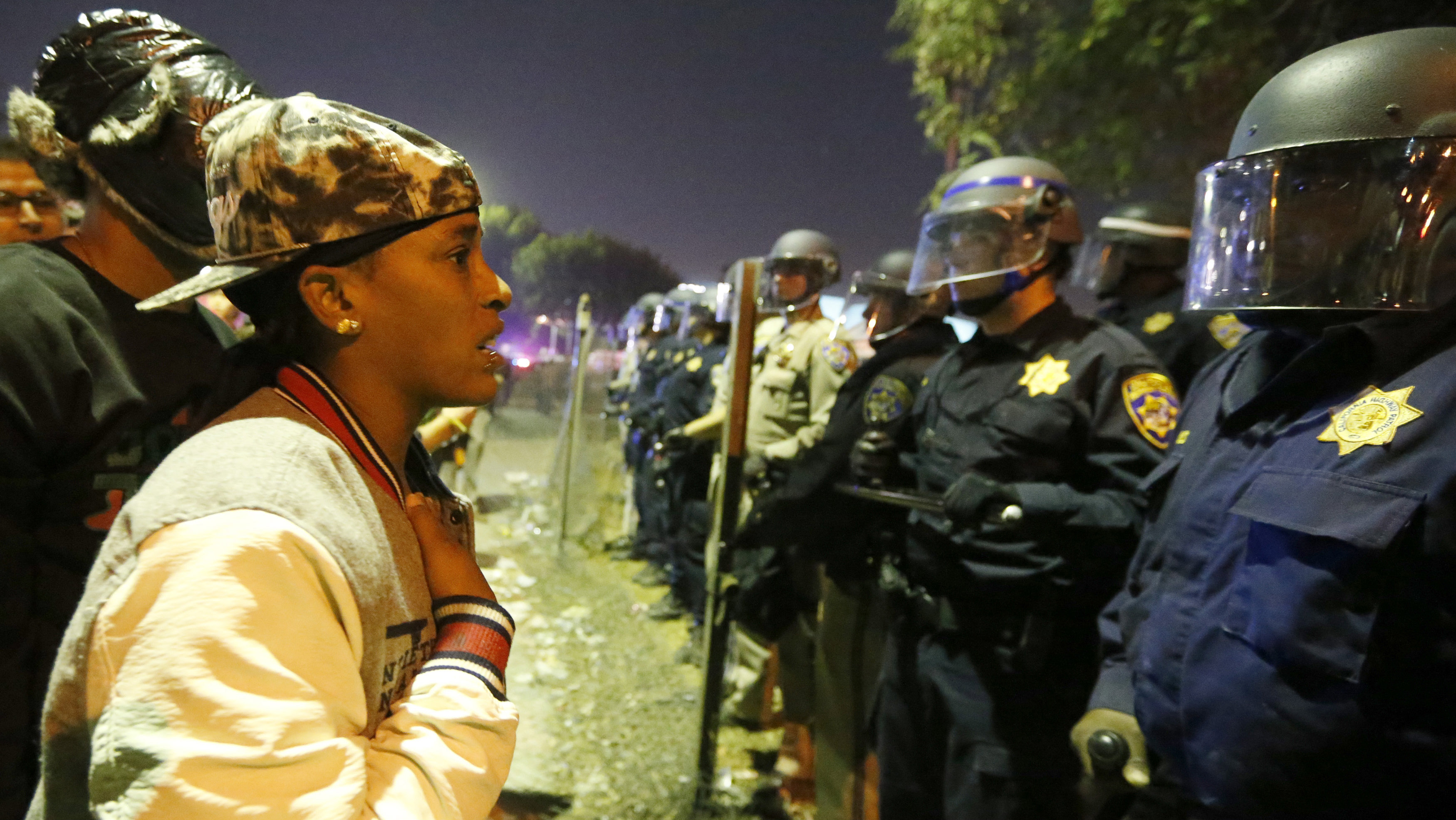 A protester talks to police during a demonstration in Los Angeles, California November 24, 2014, following the grand jury decision in the shooting of Michael Brown in Ferguson, Missouri.