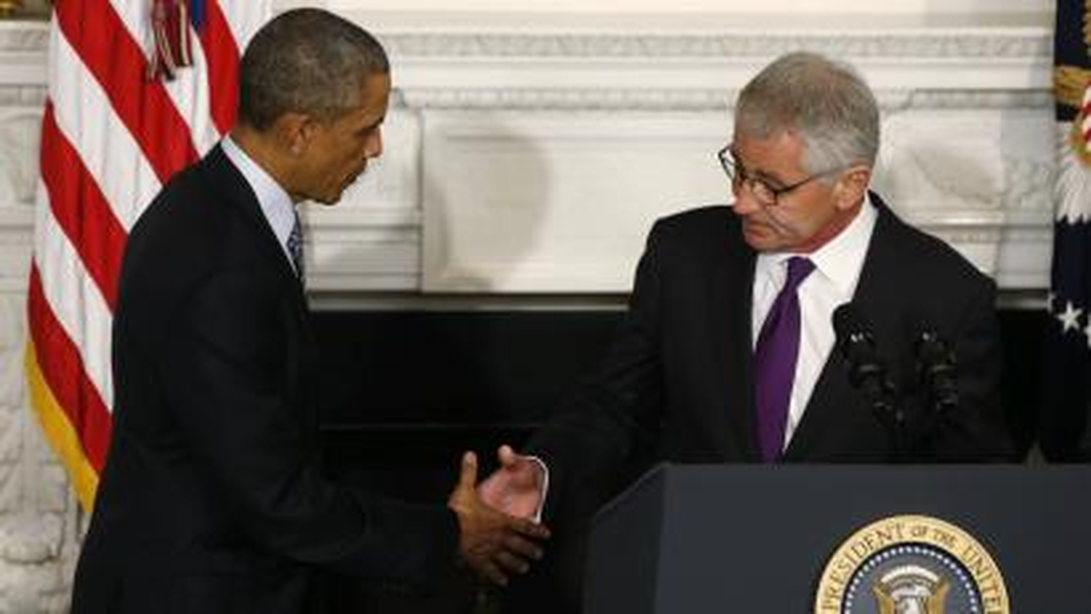 President Barack Obama says goodbye to his defense secretary Chuck Hagel, who resigned on Nov. 24, 2014.