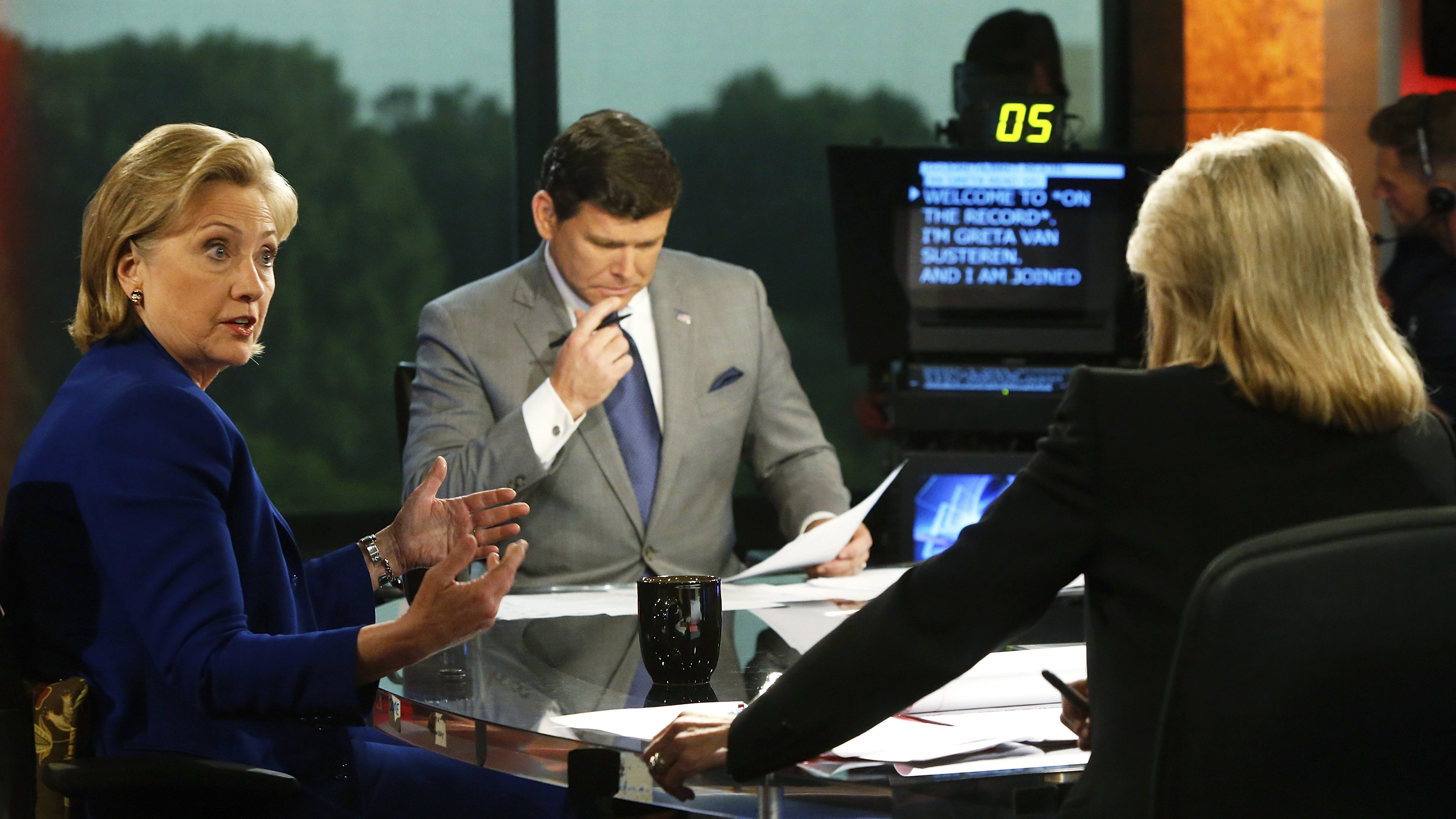 Former U.S. Secretary of State Hillary Clinton (L) chats during a commercial break during an interview with Greta Van Susteren (R) and Bret Baier at the FOX News Channel studio in Washington June 17, 2014.