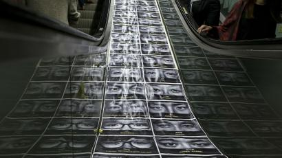 An artwork depicting photographs of occupy protesters and protest messages, made by a local artist is seen on an escalator, in the part of Hong Kong's financial central district occupied by pro-democracy protesters November 8, 2014.